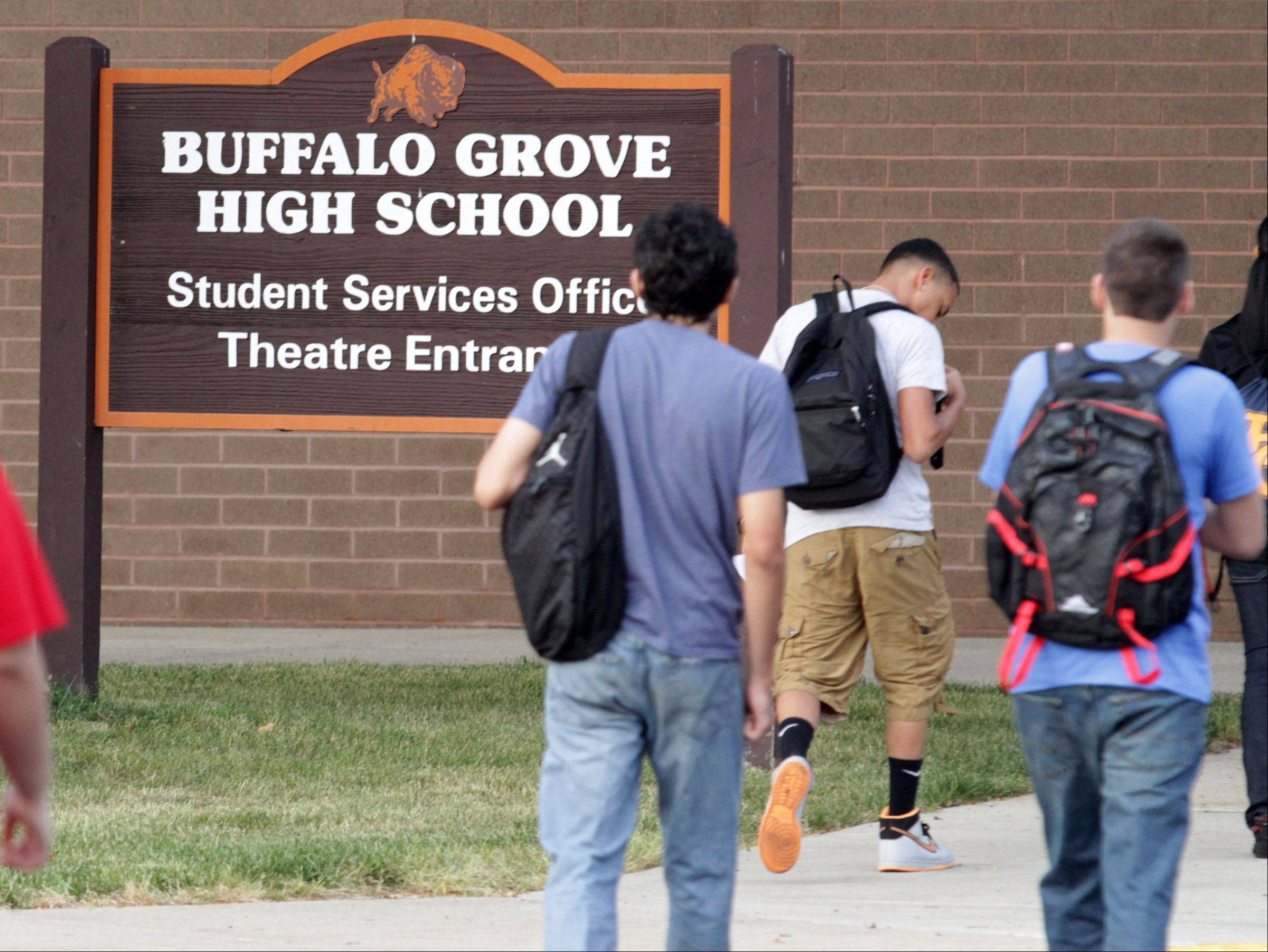 Students arrive at the first day of school at Buffalo Grove High School on Wednesday.