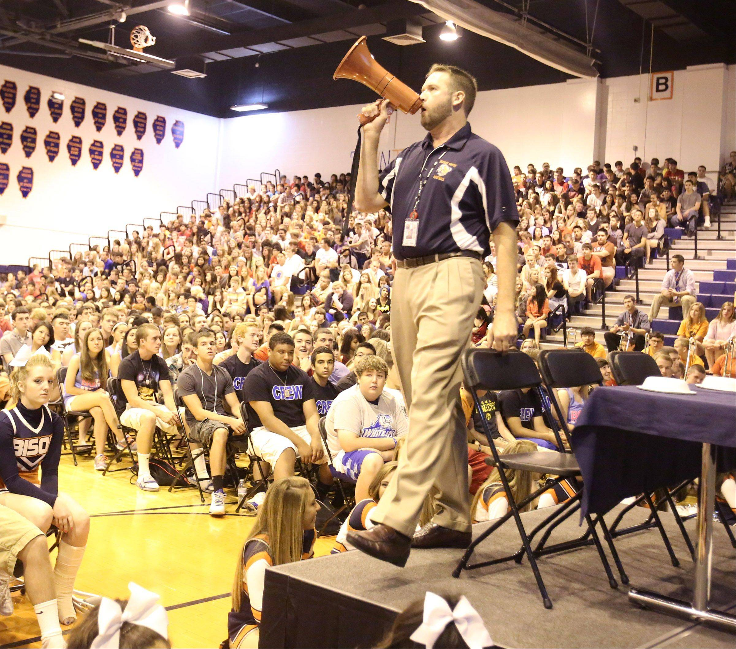 Assistant Principal Mark Schaetzlein gets on the megaphone at the morning pep rally.