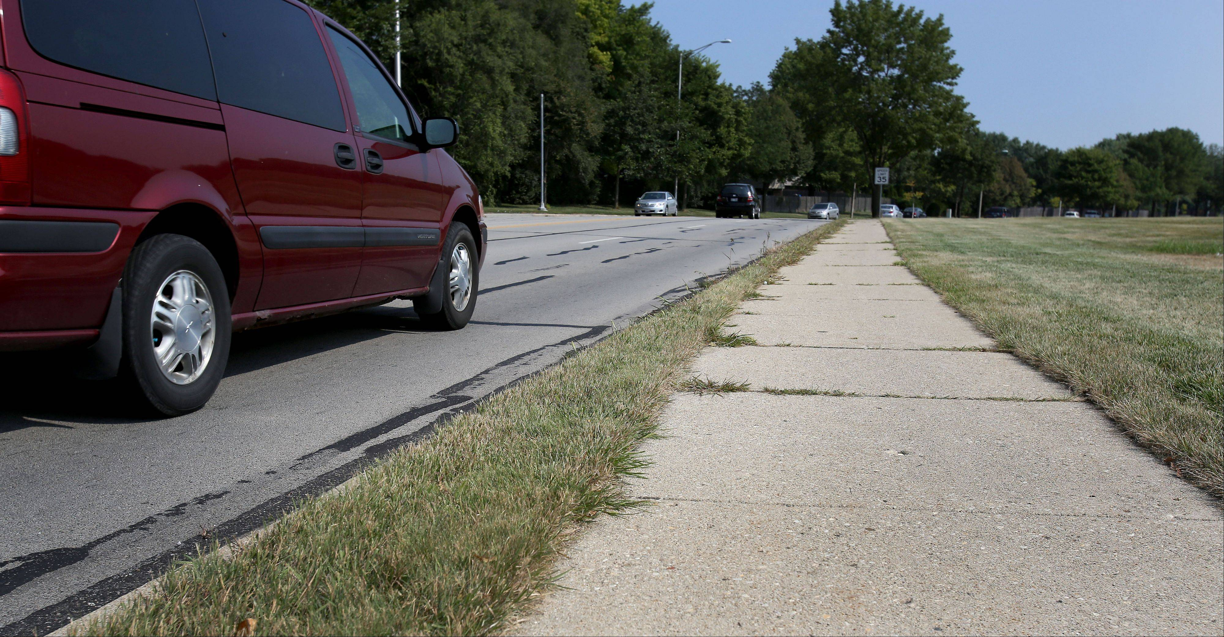 The city of Naperville will be working to move this stretch of sidewalk, on the east side of Washington Street just north of Bauer Road, further from traffic after a resident voiced concerns at Tuesday's city council meeting. The 200-foot section would cost an estimated $15,000 to move further from the road if Naperville Unit District 203, which owns the land, grants an easement.