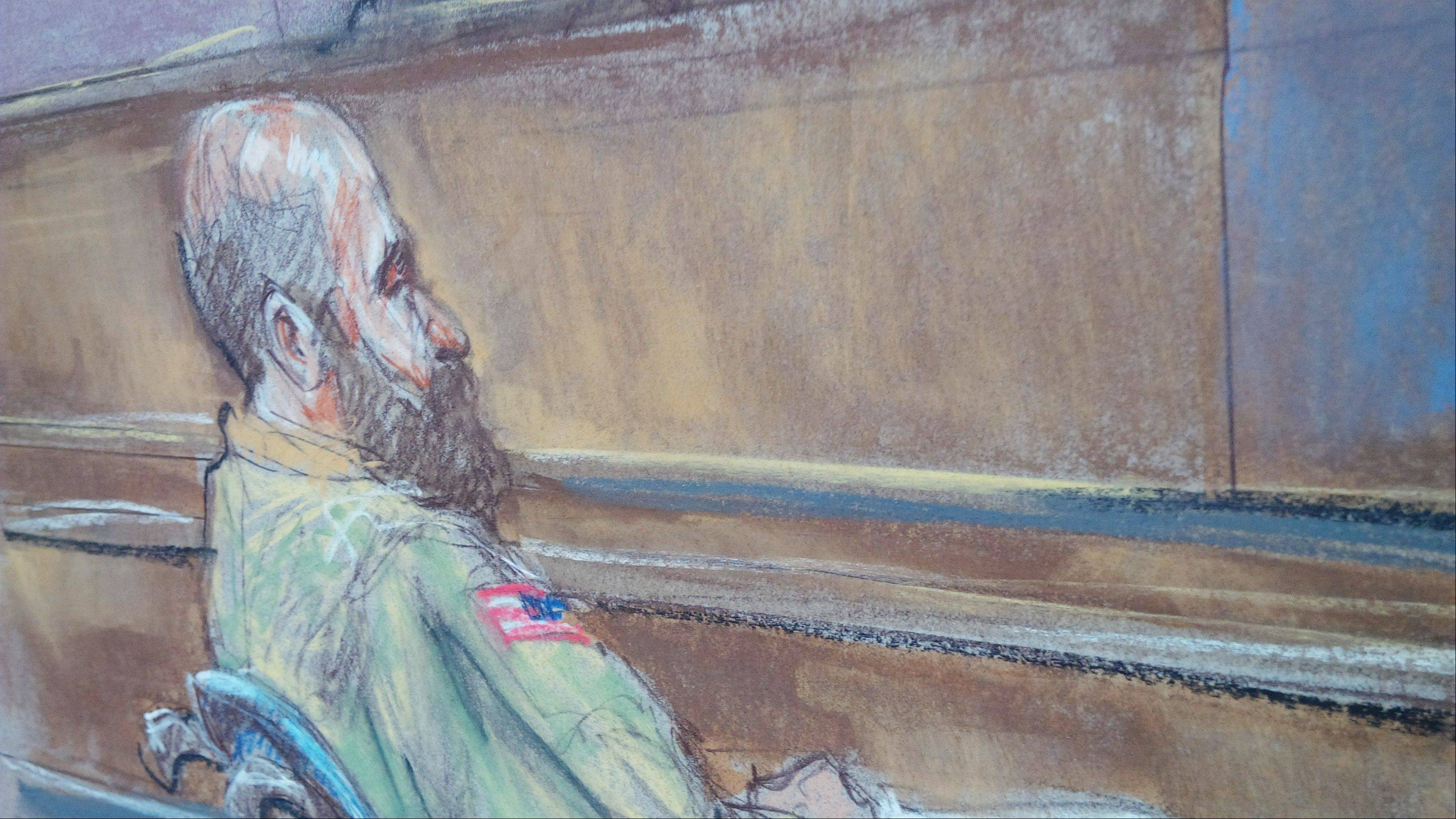 In this courtroom sketch, Maj. Nidal Malik Hasan sits Tuesday in court for his court-martial in Fort Hood, Texas. Hasan told the judge he wouldn't be calling any witnesses in his defense.