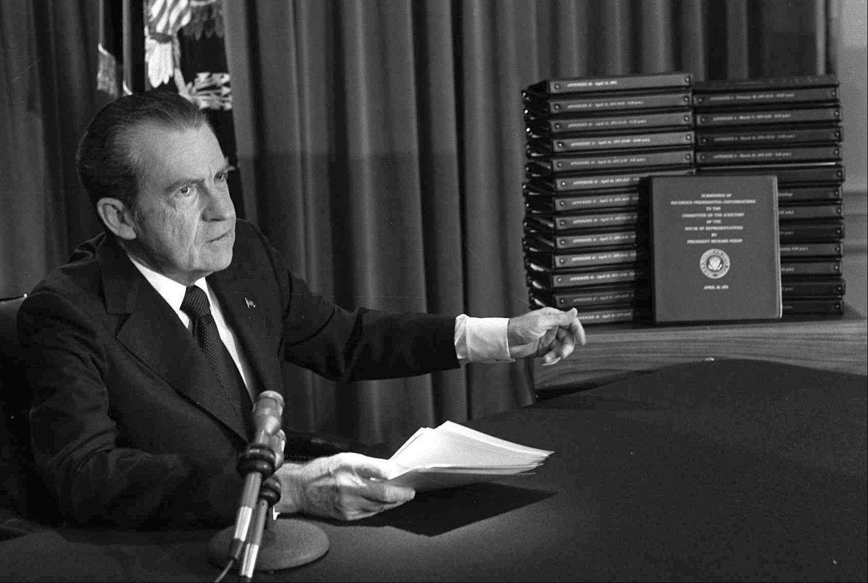 President Richard M. Nixon points to the transcripts of the White House tapes after he announced during a nationally-televised speech that he would turn over the transcripts to House impeachment investigators, in Washington. The last 340 hours of tapes from Nixon's White House were released Wednesday, along with more than 140,000 pages of text materials.