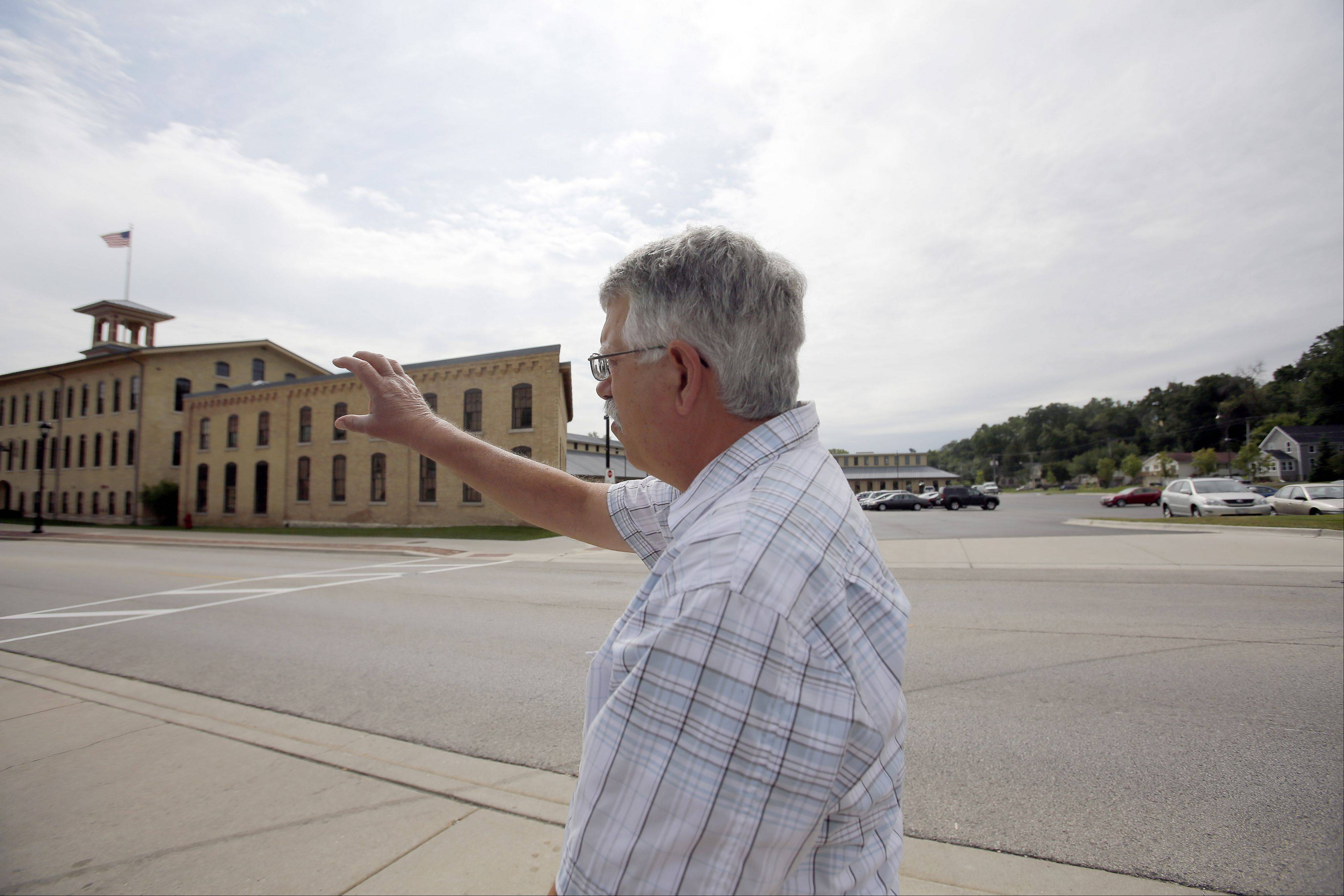 Carpentersville Village President Ed Ritter strolls past Otto Engineering, which spent millions sprucing up its portion of the Fox River.
