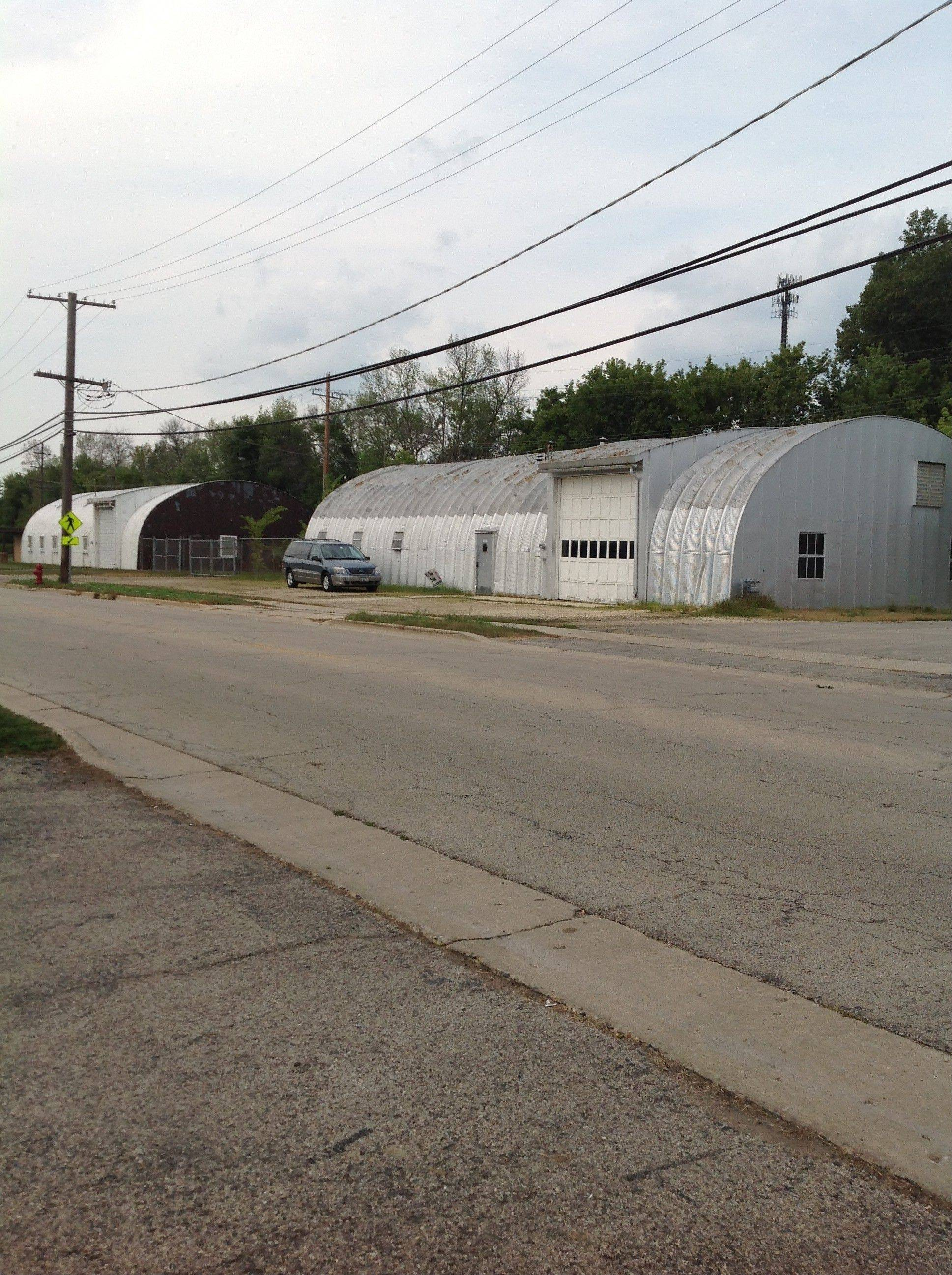 "These empty Quonset huts on Washington Street are ""probably one of the things we want to get rid of most,"" Carpentersville Village President Ed Ritter said. They are right across the street from the Fox River."