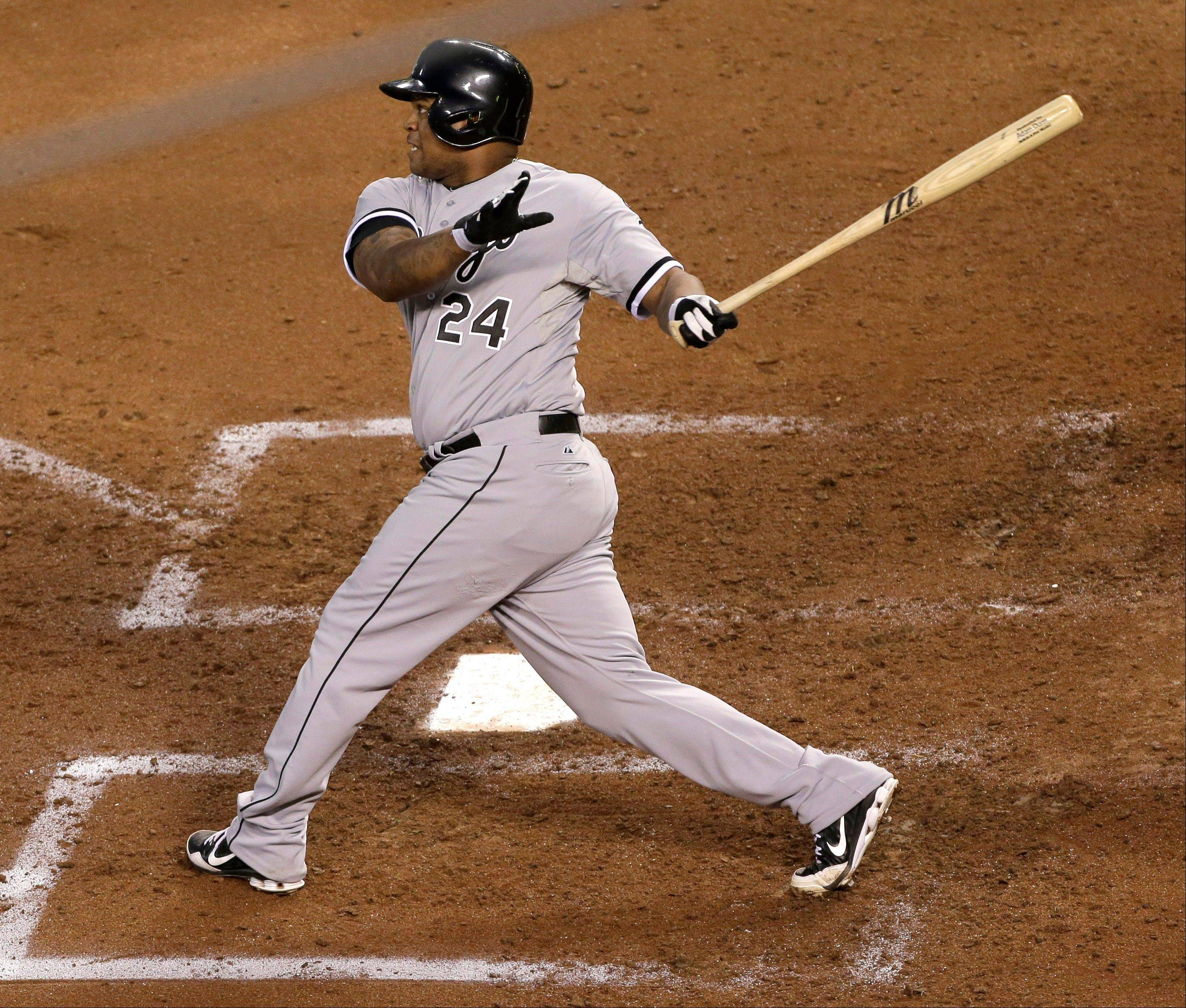 Chicago White Sox's Dayan Viciedo hits a grand slam during the fourth inning of a baseball game against the Kansas City Royals, Wednesday, Aug. 21, 2013, in Kansas City, Mo.