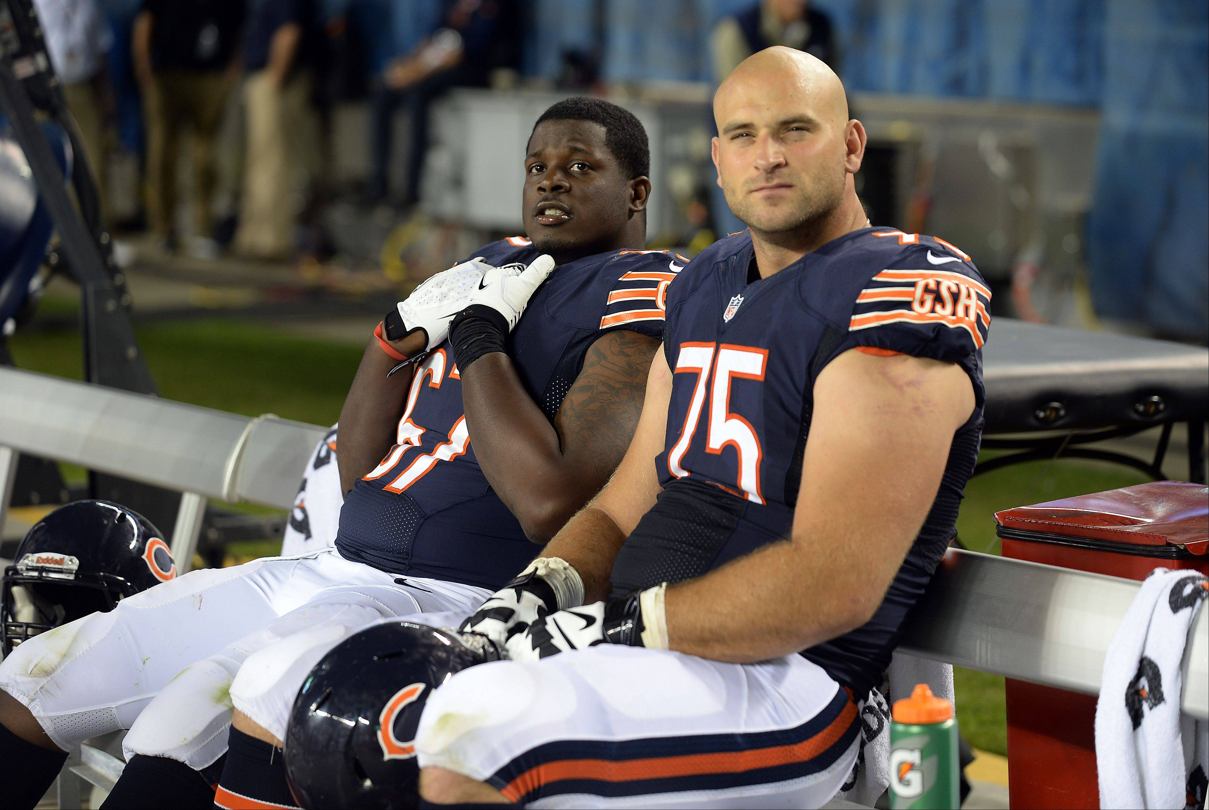 Mark Welsh/mwelsh@dailyherald.com ¬ Bears Kyle Long and Jordan Mills take a rest break in the 4th quarter in the preseason matchup against the Chargers at Soldier Field. ¬ ¬