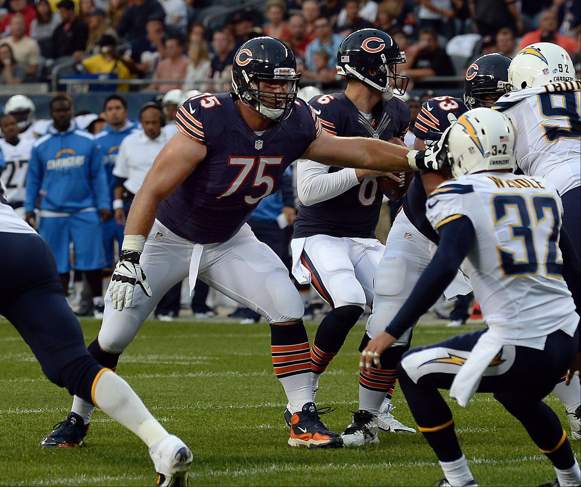 Mark Welsh/mwelsh@dailyherald.com ¬ Chicago Bears Kyle Long protects quarterback Jay Cutler as the Chargers defense rushes in the preseason matchup at Soldier Field. ¬