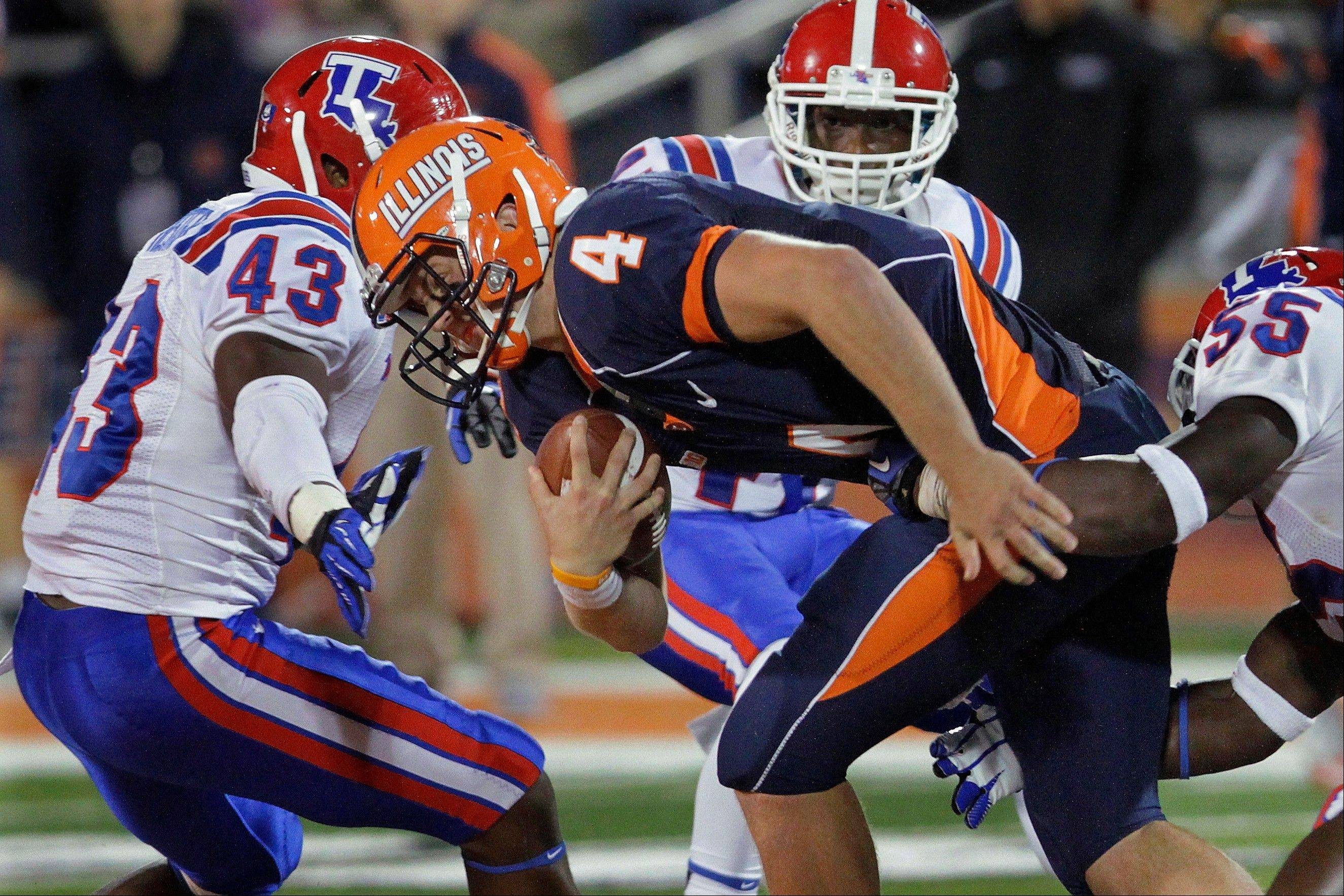 Associated Press/2012Illinois quarterback Reilly O'Toole (4) led the Illini to a nonconference win last season over Louisiana Tech, but he struggled in some Big Ten games.