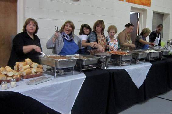 Supporters of last year's One Hope Ministries benefit enjoy the buffet dinner. This year's benefit will be held Sept. 7, at Living Hope Church, in Elk Grove Village. The public is invited.