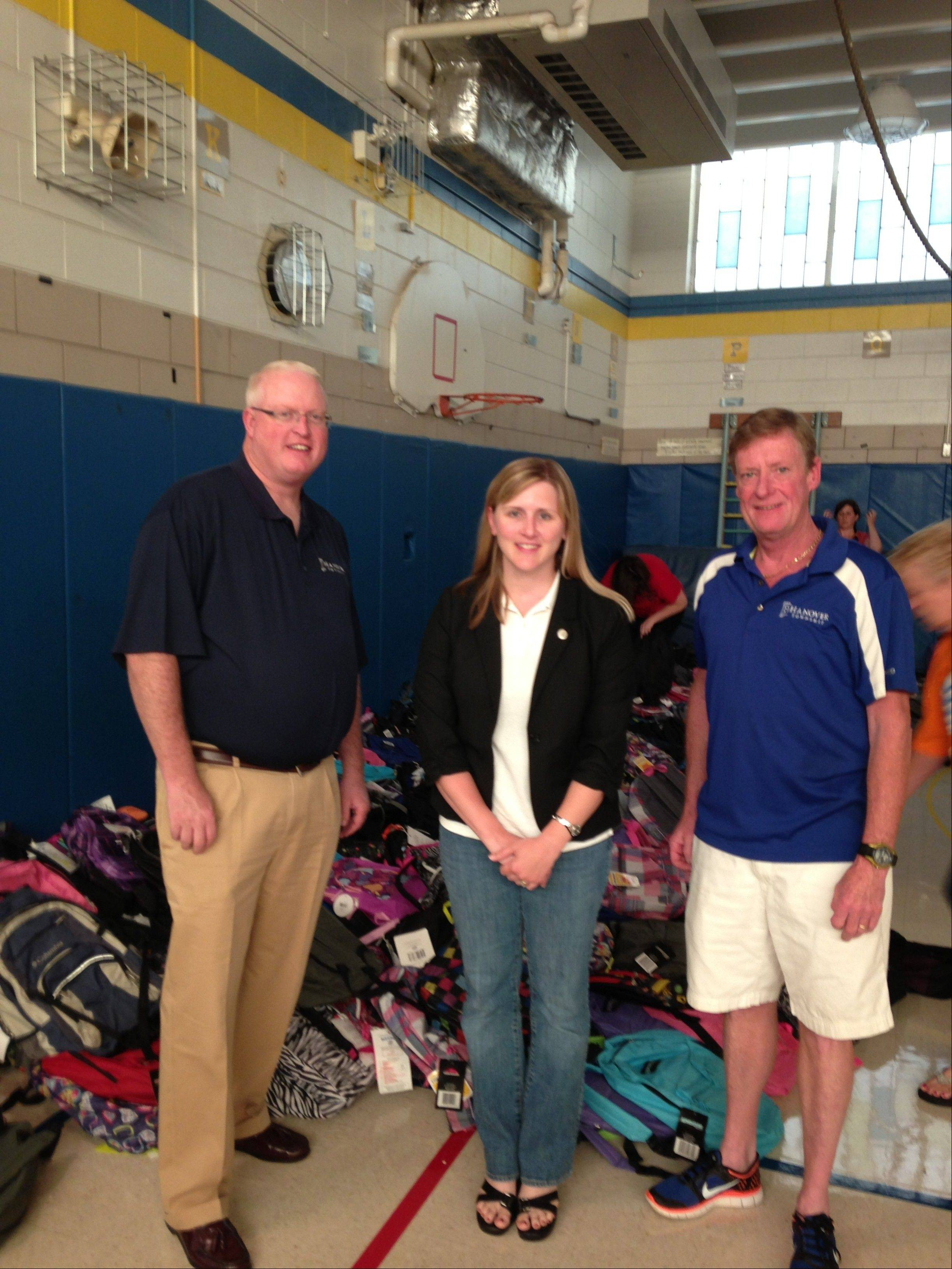 Hanover Township Supervisor Brian McGuire, AT&T representative Jaci Kator and Hanover Township Trustee Howard Krick were part of the group that distributed more than 1,000 backpacks to needy families last week.
