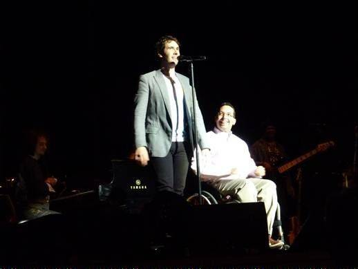 "Seth Goldberg, right, appears onstage with Josh Groban who sings his hit, ""You Raise Me Up."""