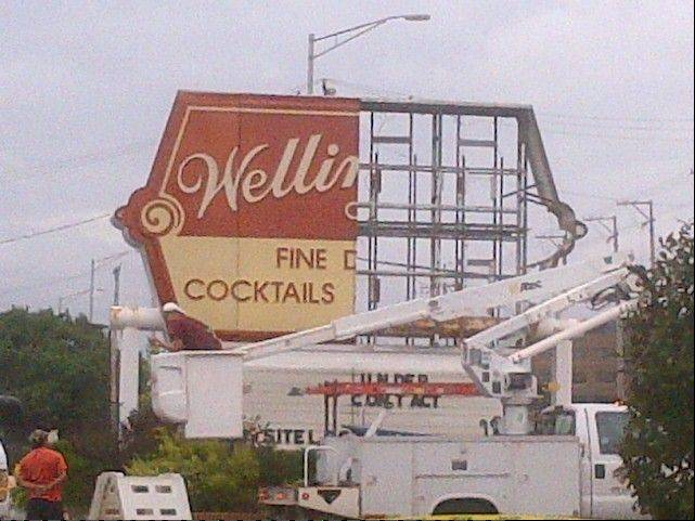 The sign outside the landmark Wellington Restaurant on Arlington Heights Road comes down Thursday, Aug. 22.