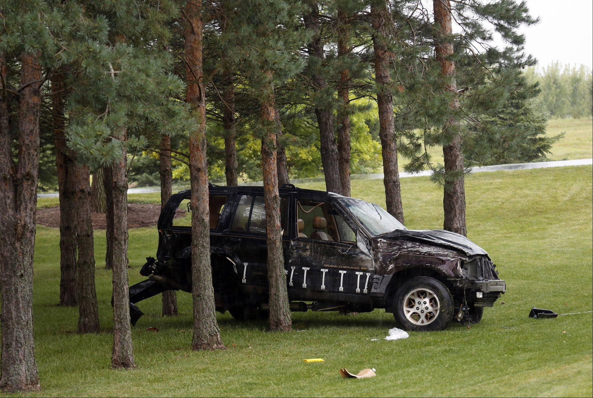 An SUV rests among trees on the south side of Marengo Road after a one-car accident just west of Diekman Road Thursday morning near Huntley.