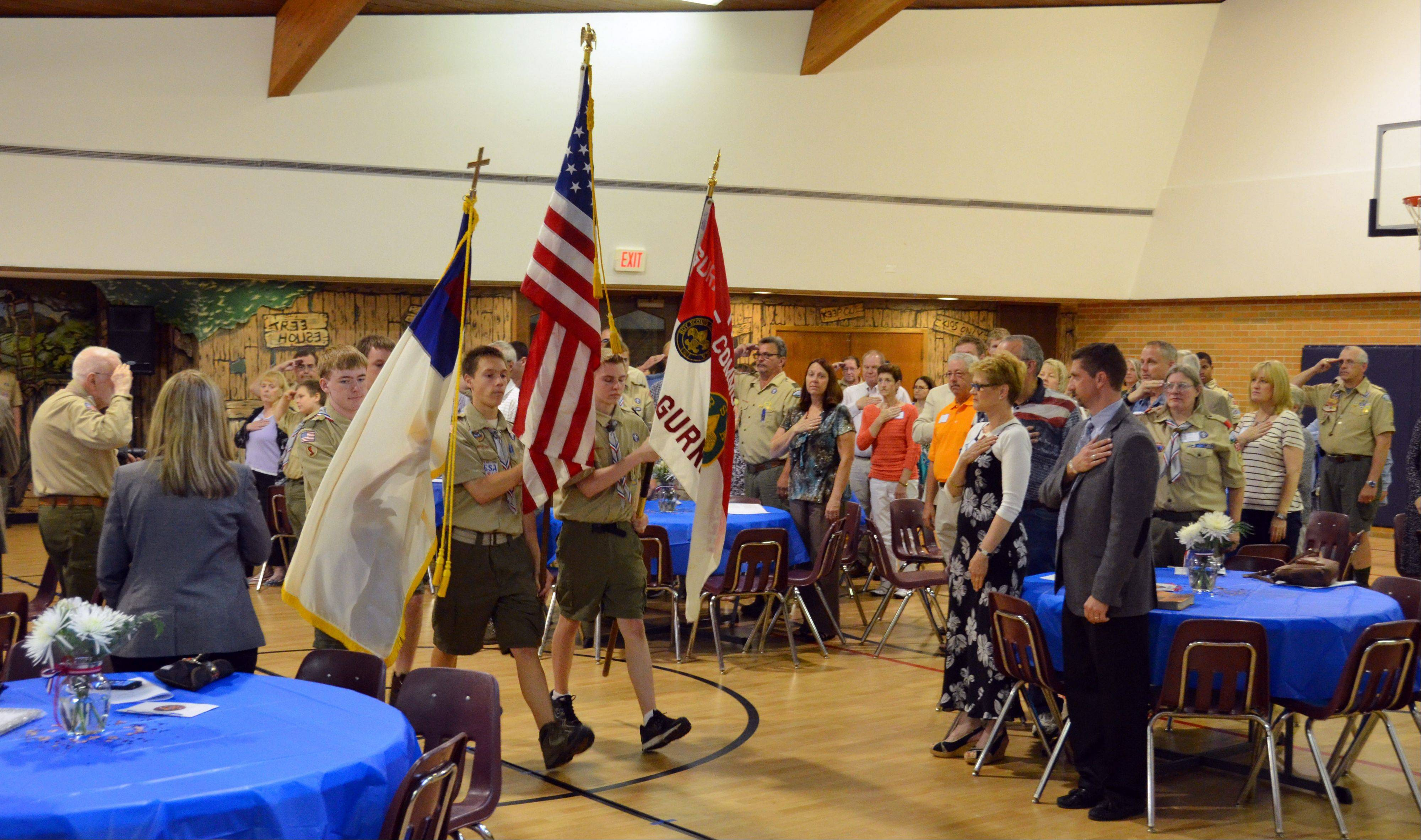 Gurnee Boy Scout Troop 677 start their 100 year anniversary celebration this year with a flag ceremony.