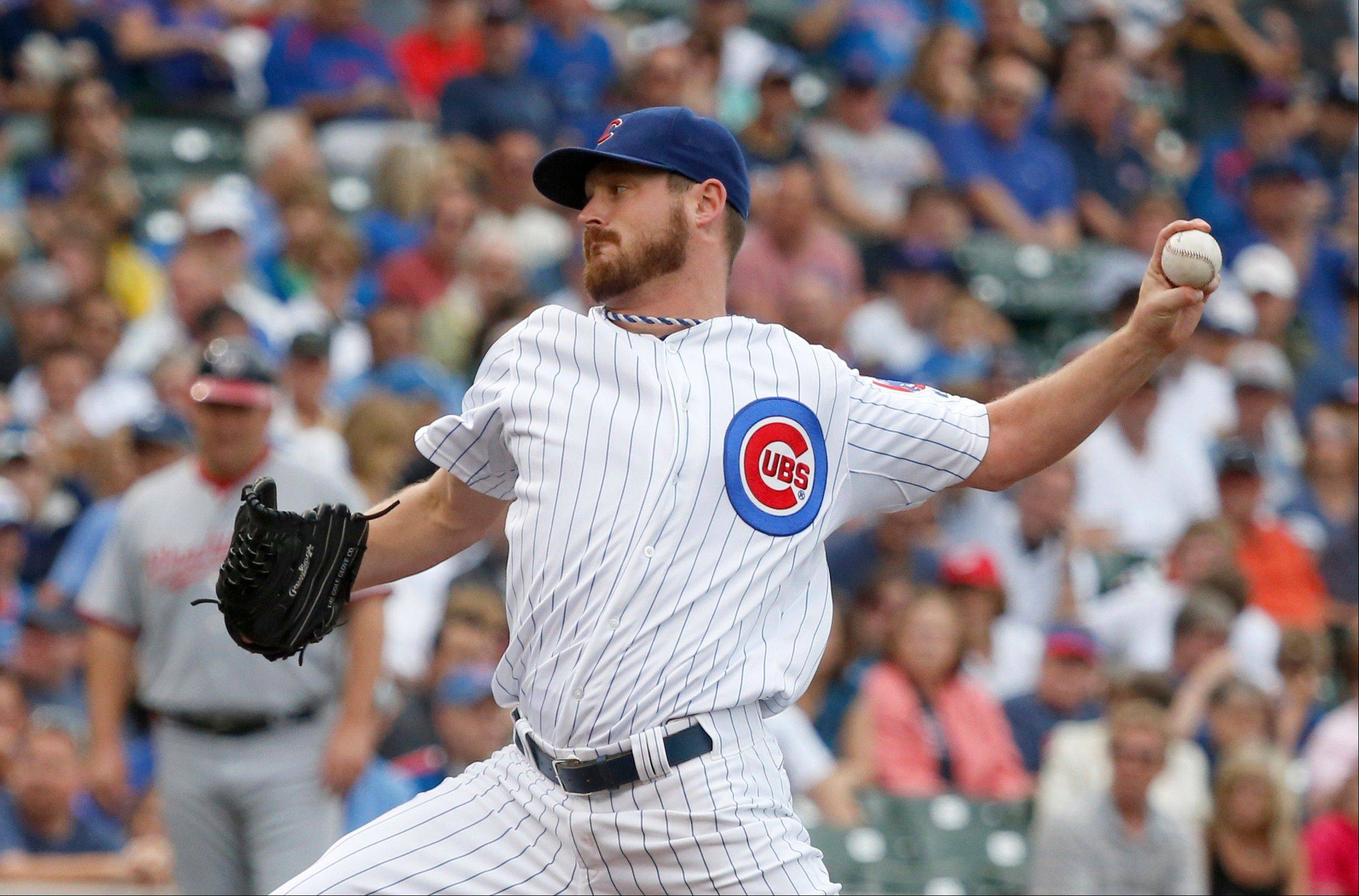 Travis Wood delivers during the first inning of a baseball game against the Washington Nationals on Thursday, Aug. 22, 2013, in Chicago.