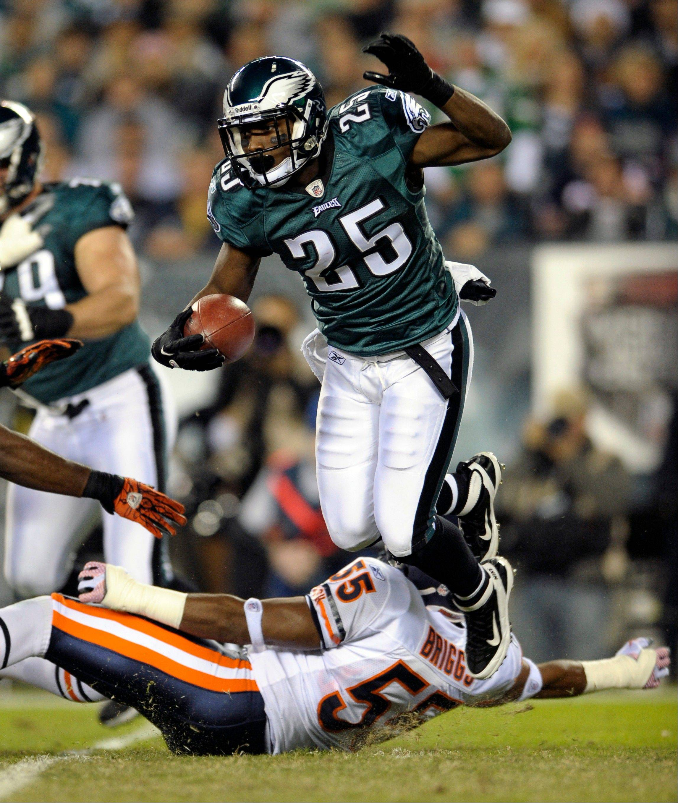 Eagles running back LeSean McCoy jumps over the Bears� Lance Briggs in a game in 2011. McCoy is ranked fifth among running backs for fantasy football purposes, according to John Dietz.