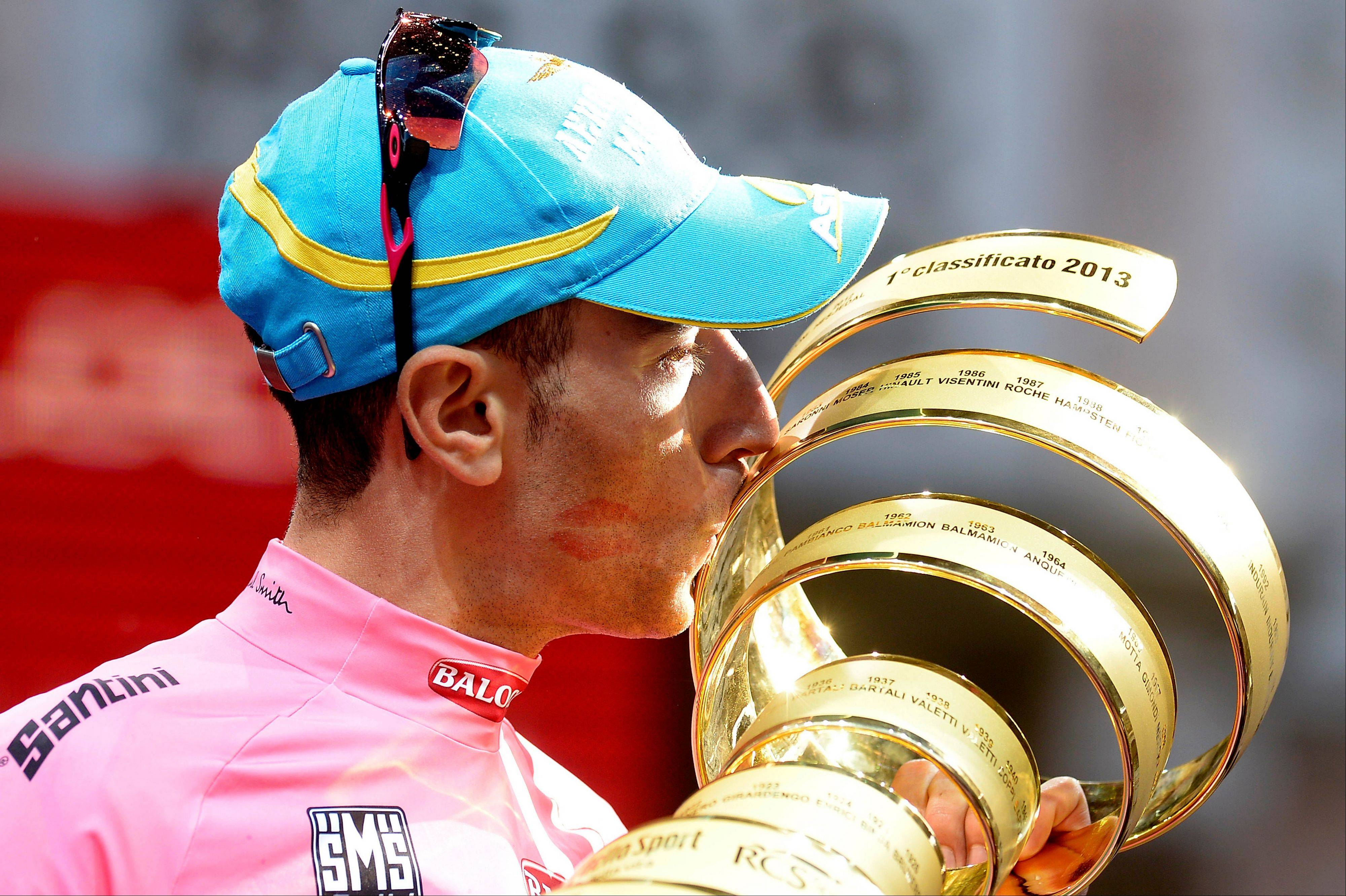 Italy�s Vincenzo Nibali kisses the trophy after winning the Giro d�Italia in May. Nibali will be seeking his second major title of the year when the mountain-heavy Spanish Vuelta begins on Saturday.