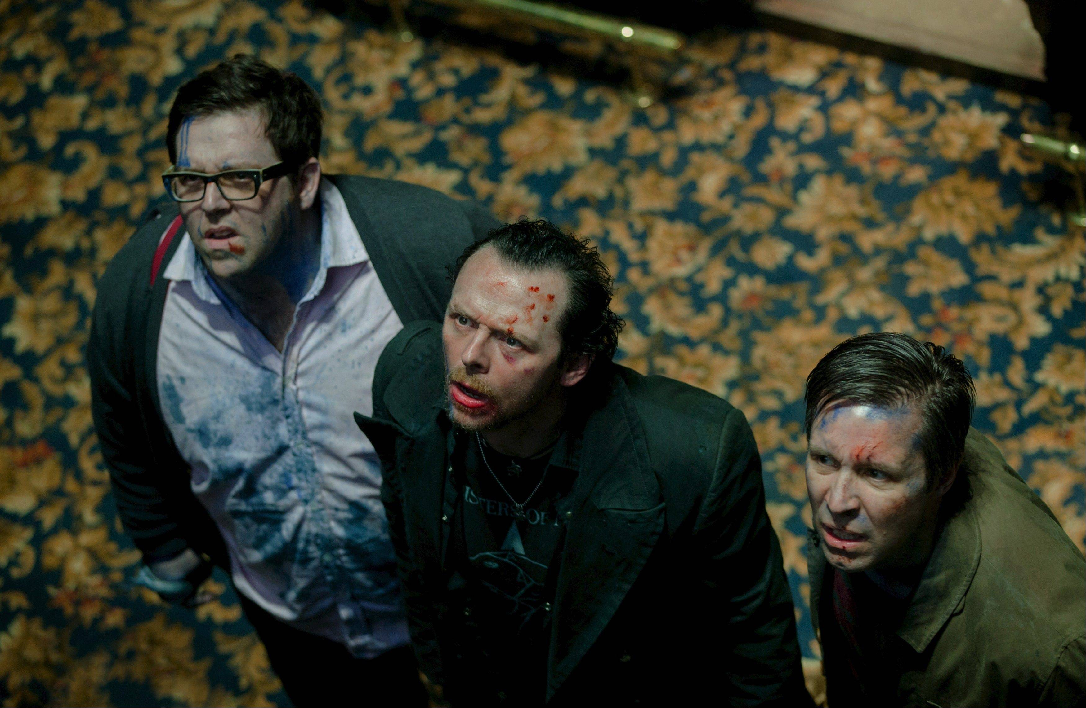 "Gary (co-writer Simon Pegg), center, and two pals get much more than they anticipated while attempting to recreate their college pub crawl in ""The World's End."""