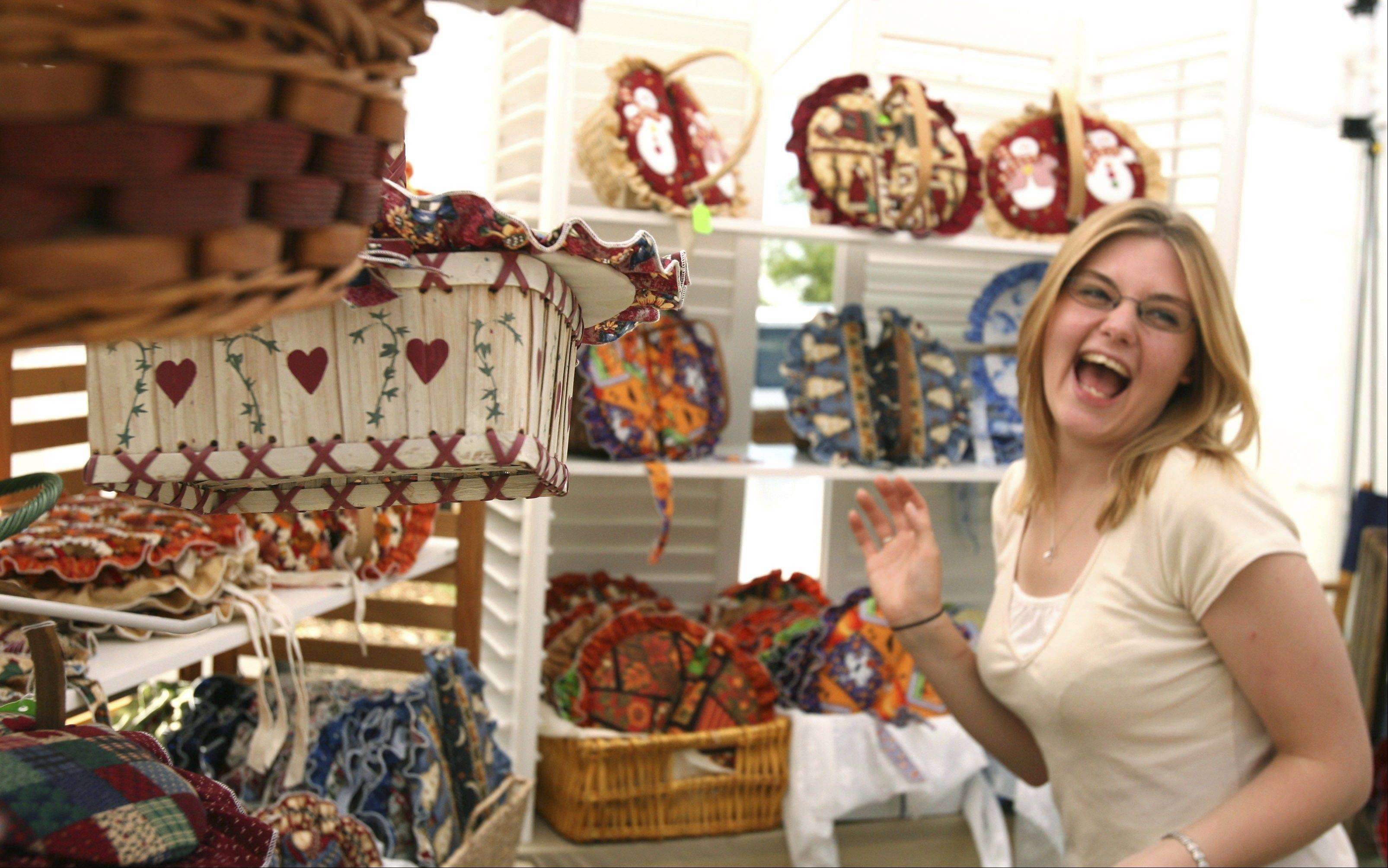 Courtney Kozeleh of Capron, Ill., selling crafts at the 2007 Buffalo Grove Days festival, jokes with a customer.