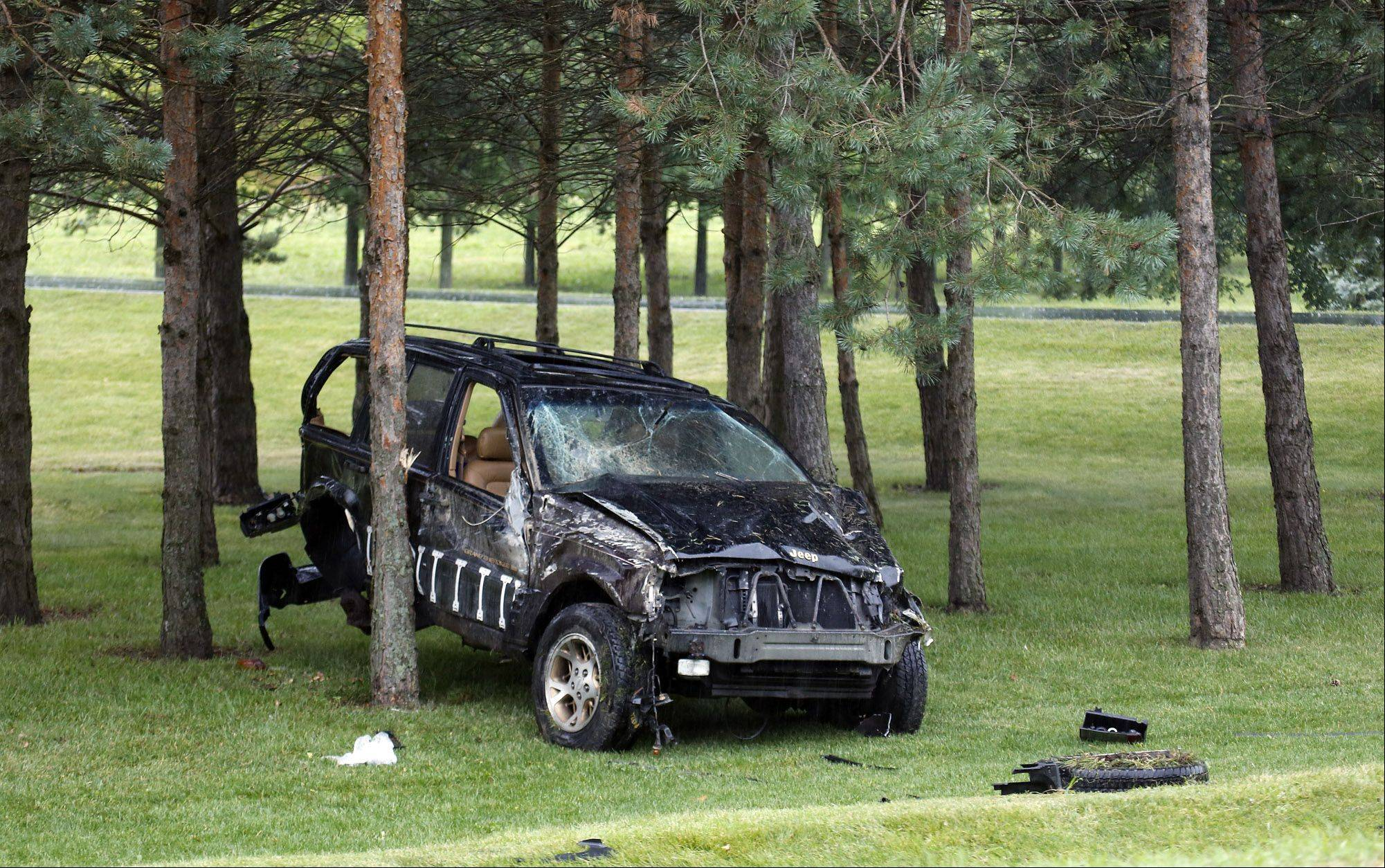 An SUV sits on the south side of Marengo Road after a one-car accident Thursday morning.