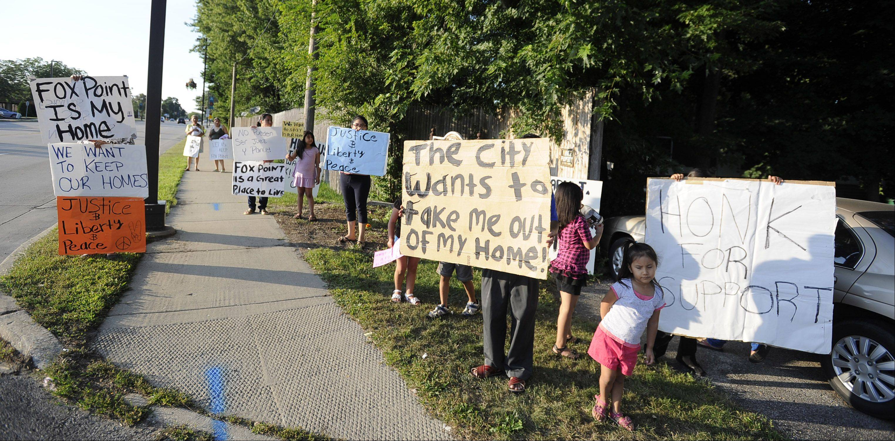 Residents of Fox Point mobile home park along Milwaukee Avenue in Wheeling protest last Friday, alleging the village is trying to displace them.