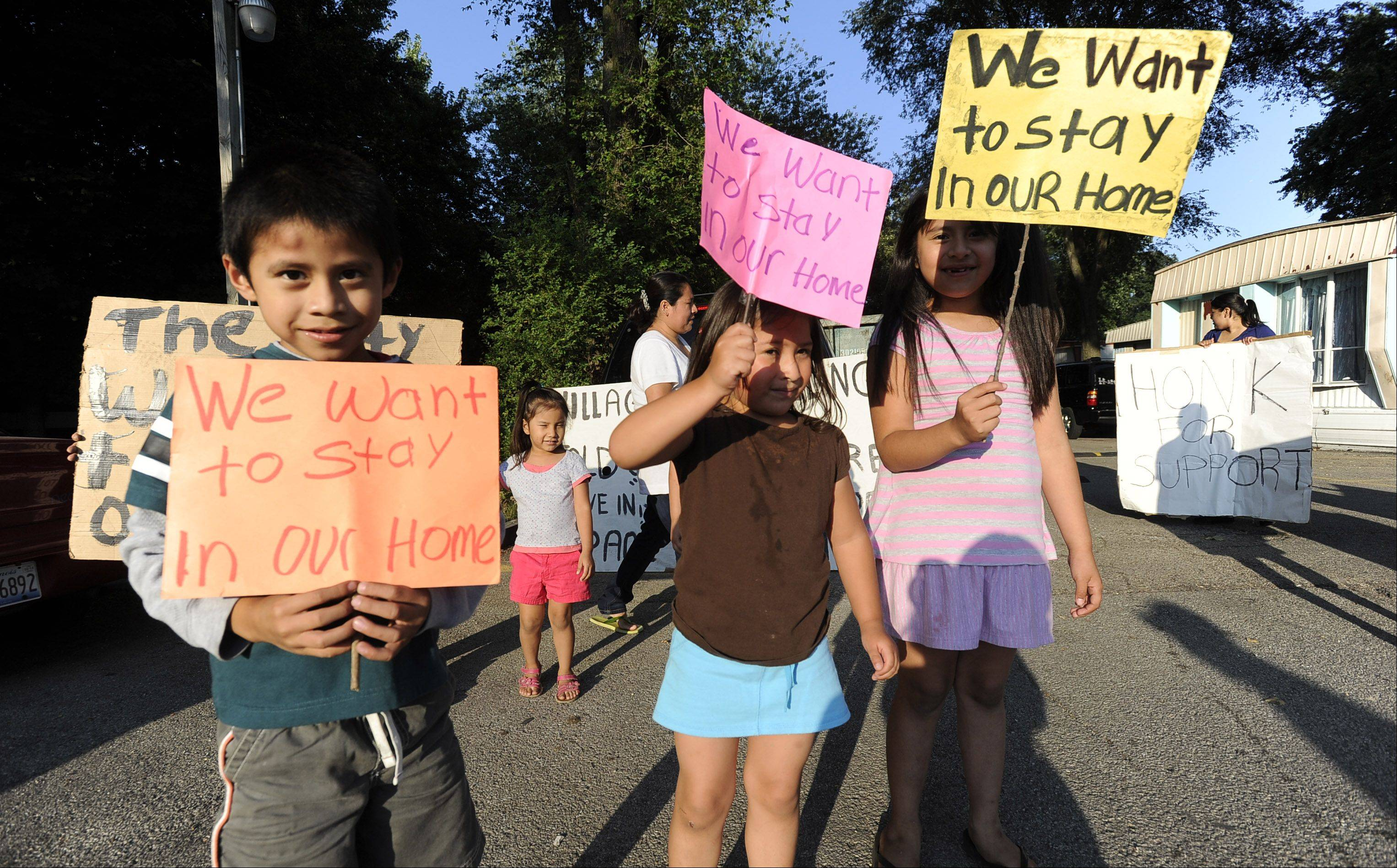 Yair Carreno, 5, Gabnela Guillen, 4, and Areli Carreno, 7, join the protest last Friday