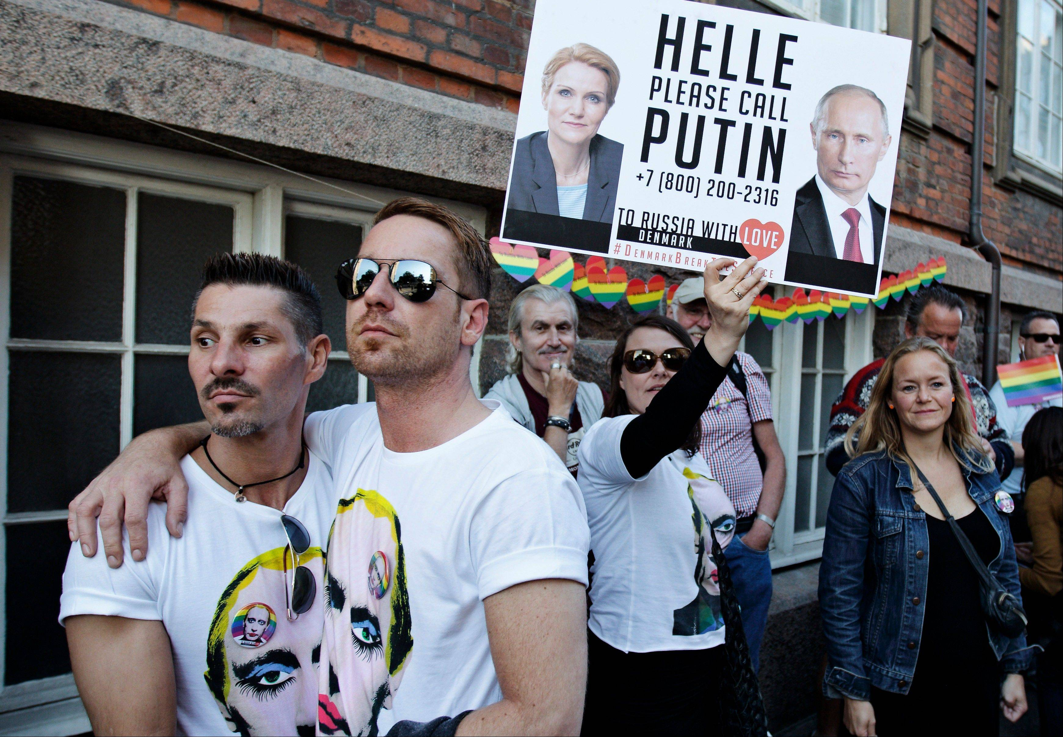 Protesters march to the Russian Embassy in Copenhagen, Denmark, to rally against the Russian Parliament's law that directly criminalizes homosexual so-called 'propaganda' to children and adolescents.