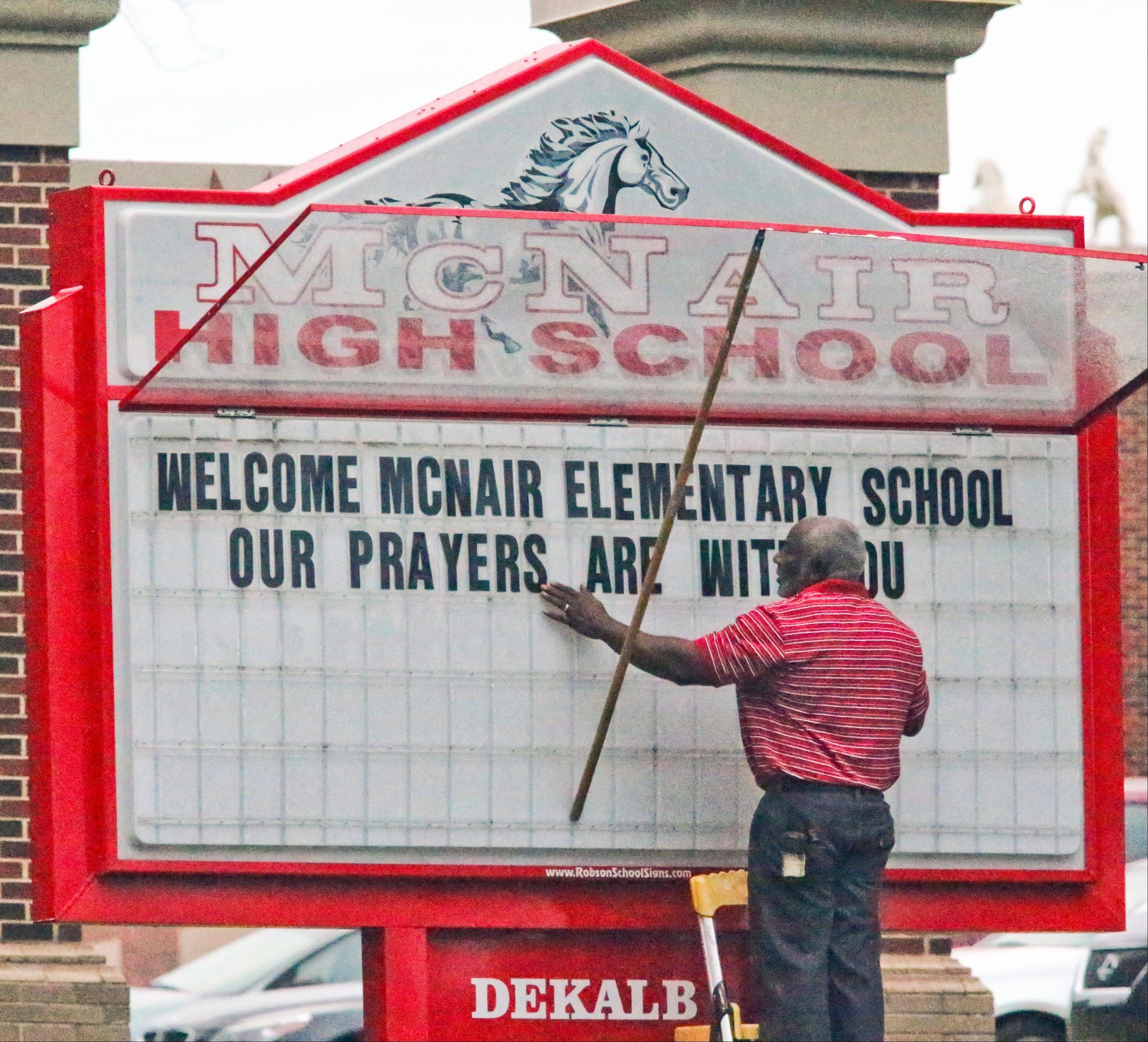 Ronald E. McNair Discovery Learning Academy held classes at McNair High School on Wednesday after a gunman on Tuesday held one or two staff members captive and fired into the floor of the school office.
