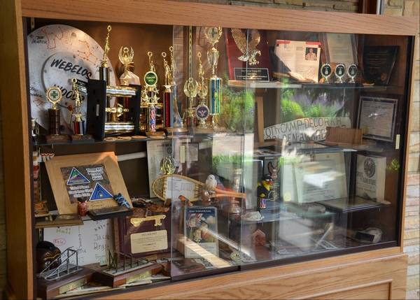 A Case Holds Items Collected By Gurnee Boy Scout Troop 677