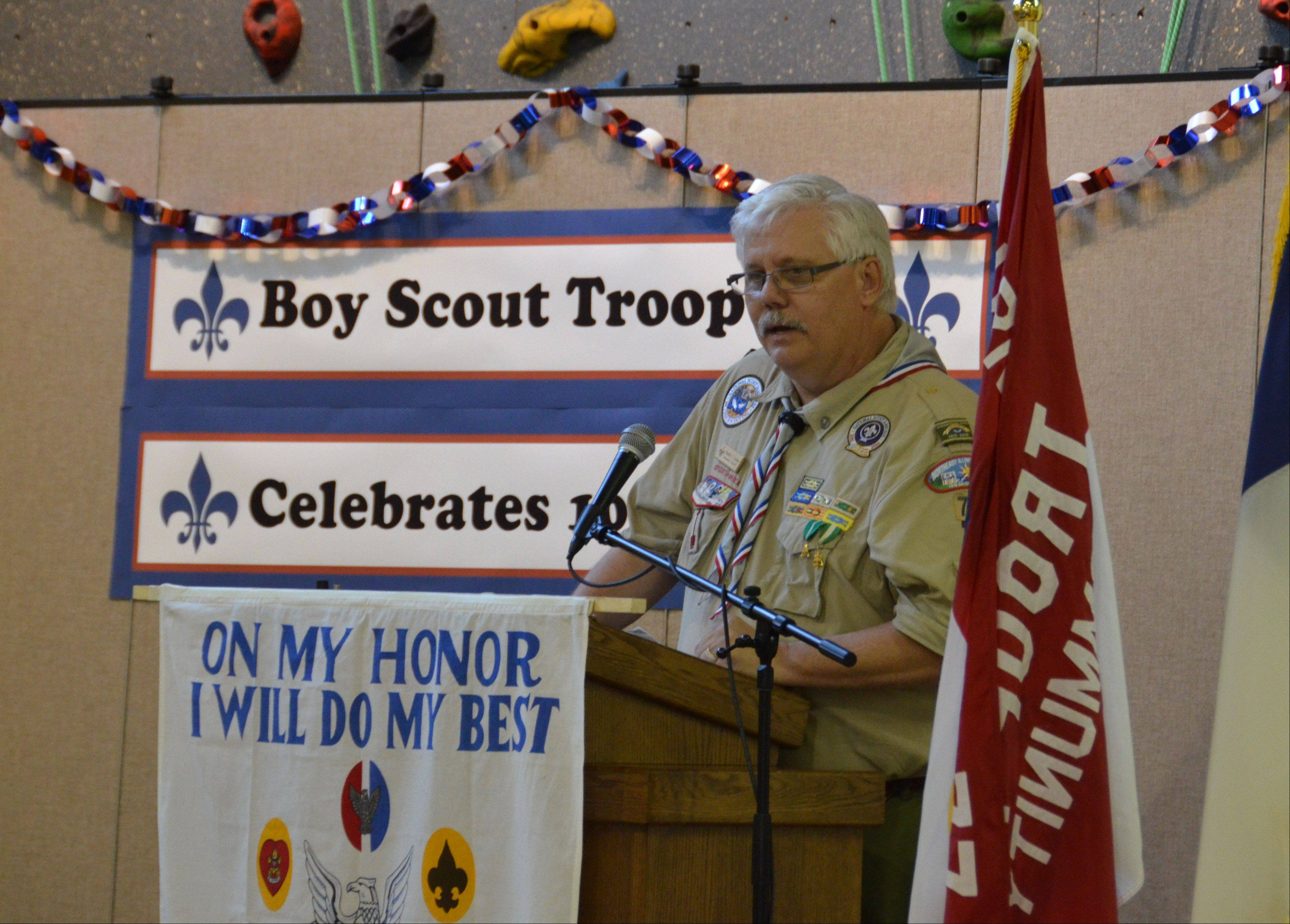 Gurnee Boy Scout Troop 677 celebrates their 100 year anniversary and the troop's scoutmaster Brad Carlson says a few words during the ceremony.
