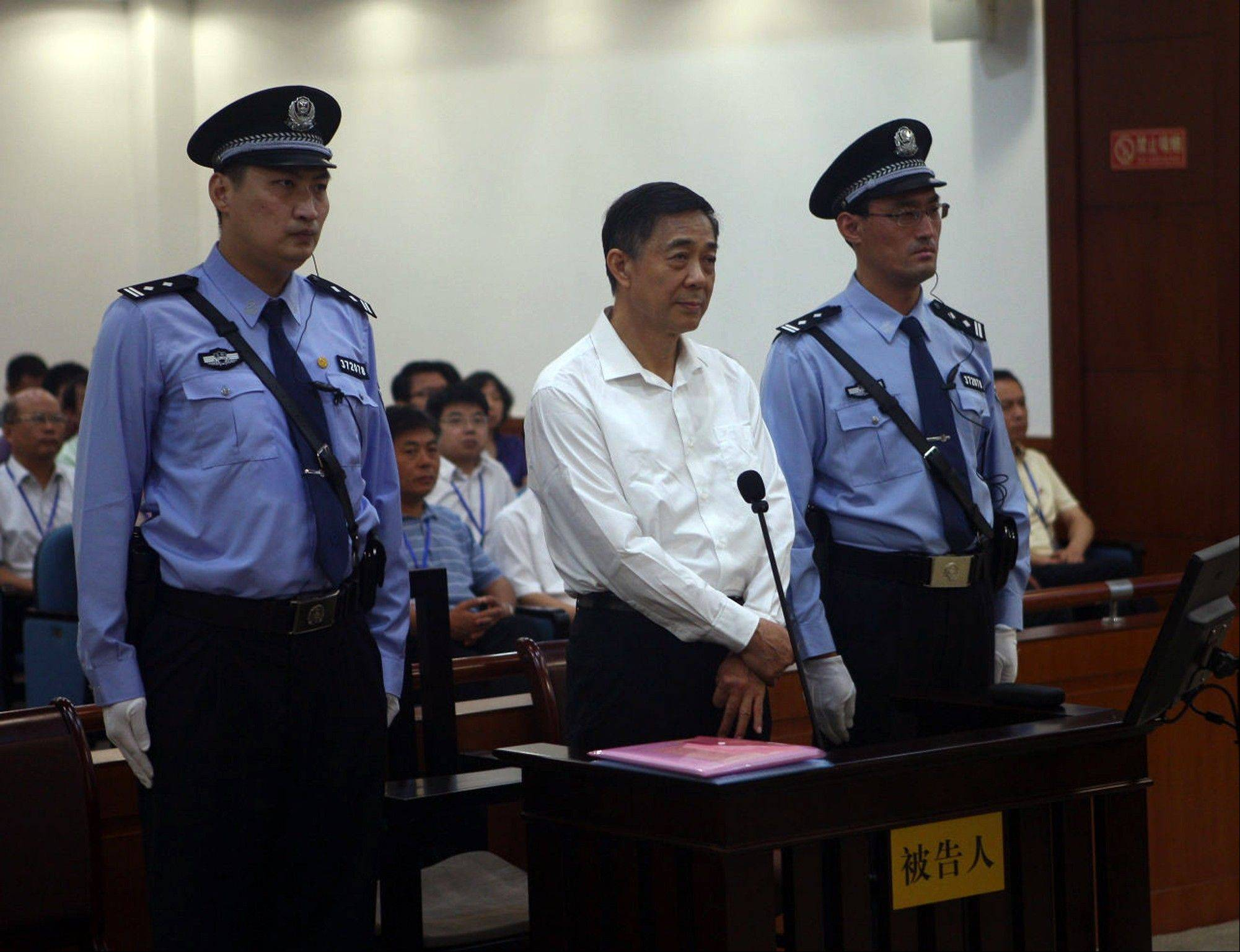 In this photo released Thursday by the Jinan Intermediate People's Court, Bo Xilai, center, stands on trial at the court in eastern China's Shandong province. The disgraced populist politician went on trial Thursday accused of abuse of power and netting more than $4 million in bribery and embezzlement, marking the ruling Communist Party's attempts to put to rest one of China's most lurid political scandals in decades.