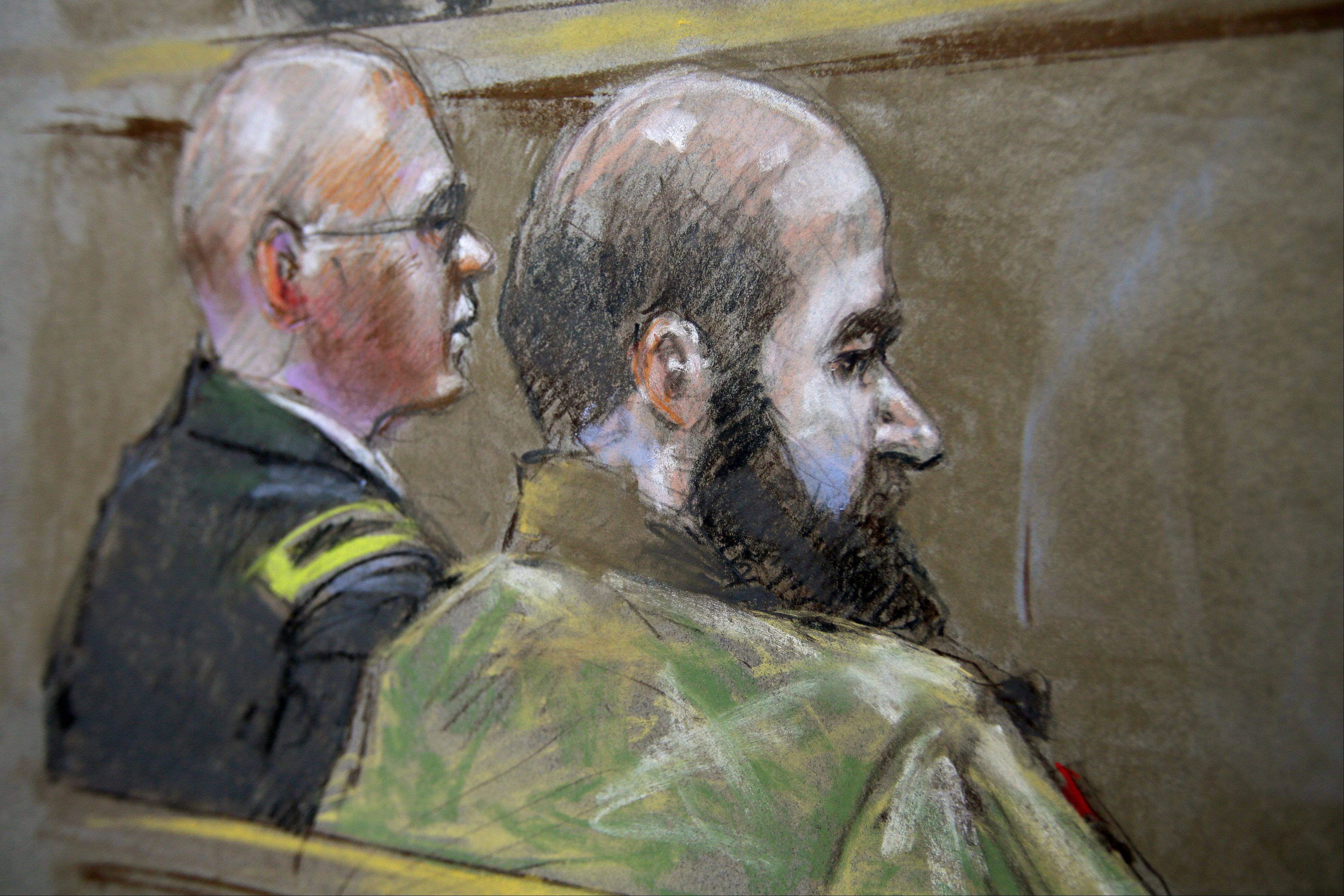 In this courtroom sketch of court proceedings Wednesday in the court martial of U.S. Army Maj. Nidal Malik Hasan, Hasan, right, and his defense attorney, Lt. Col. Kris Poppe, left, are shown in Fort Hood, Texas. Hasan rested his case Wednesday without calling any witnesses or testifying in his own defense. Hasan is accused of killing 13 people and wounding more than 30 others at the Texas military base in November 2009.