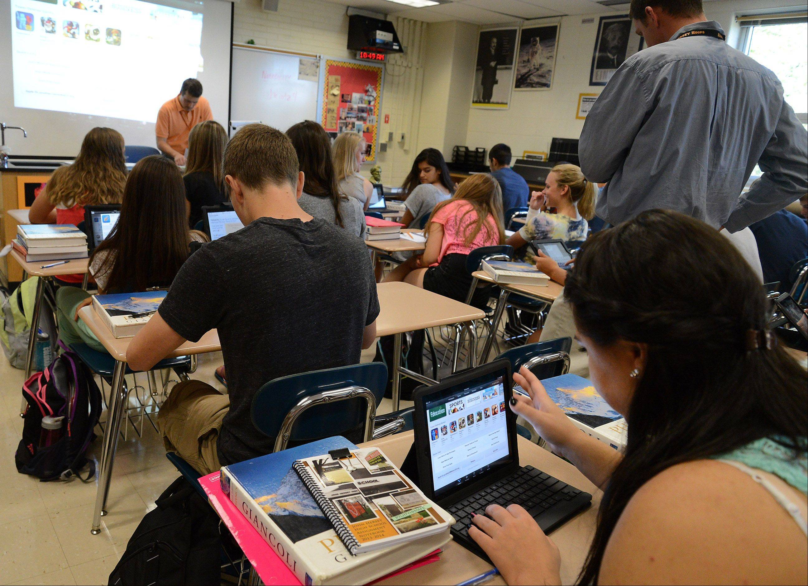 Honors physics teacher Jon Heintzelman's class makes use of iPads on the first day of classes at Hersey High School.