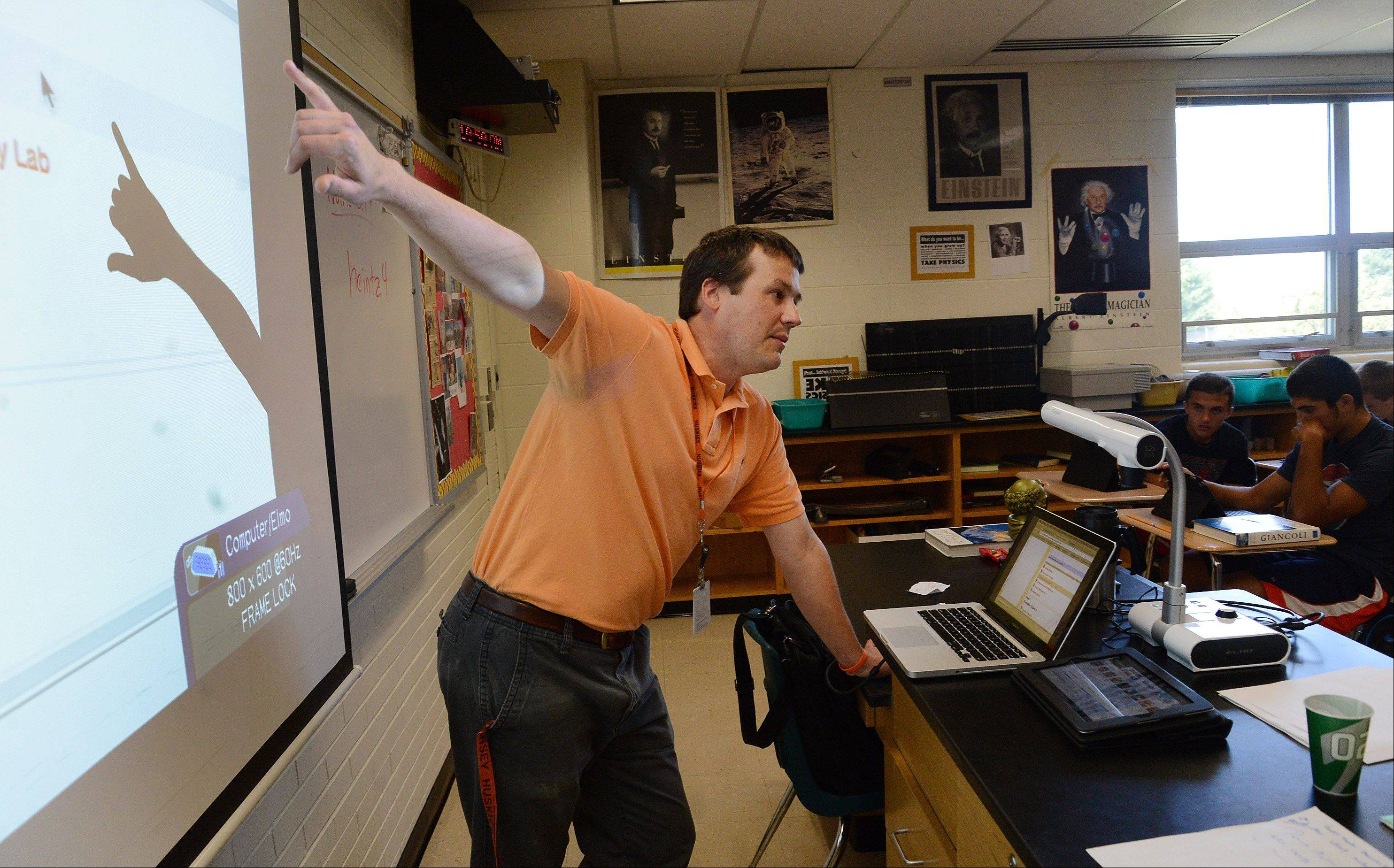 Honors physics teacher Jon Heintzelman teaches students how to use their iPads on the first day of classes at Hersey High School.