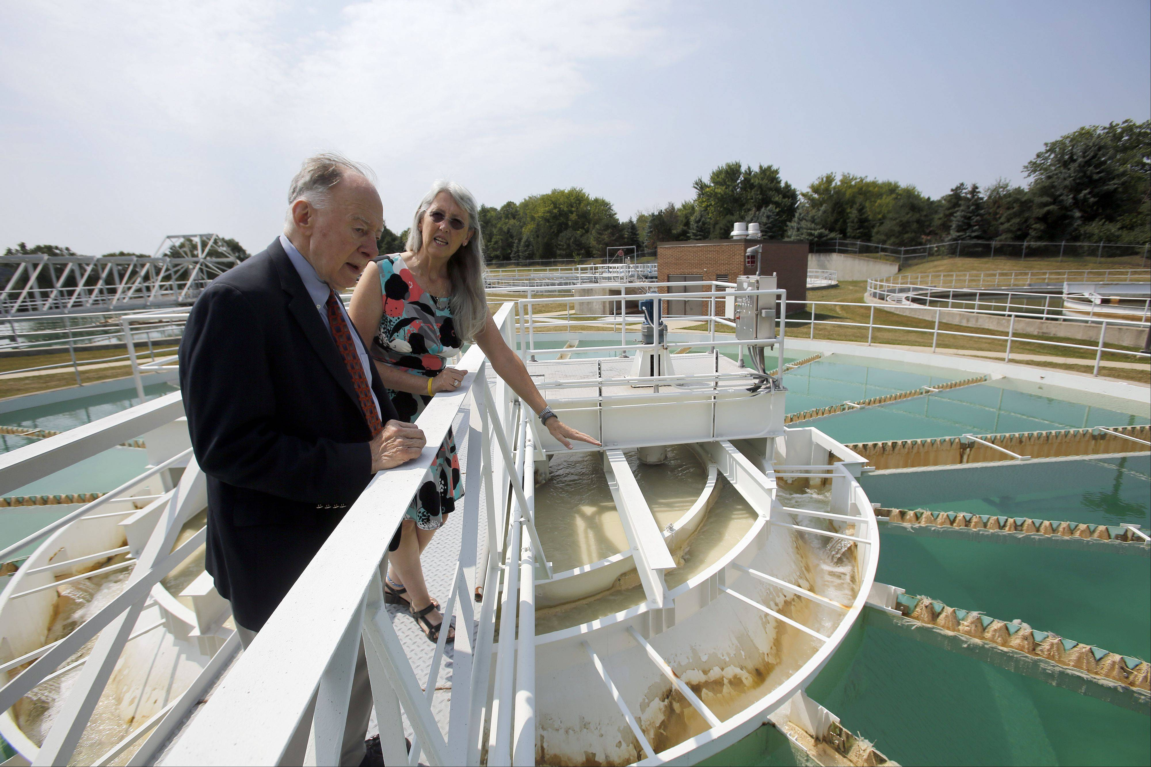 Elgin Water Director Kayla Jacobsen leads former Elgin City Manager Leo Nelson on a tour of the Riverside Drive Water Treatment Plant, which the city plans to name after Nelson. Nelson spearheaded the controversial idea of building the facility in the 1970s.