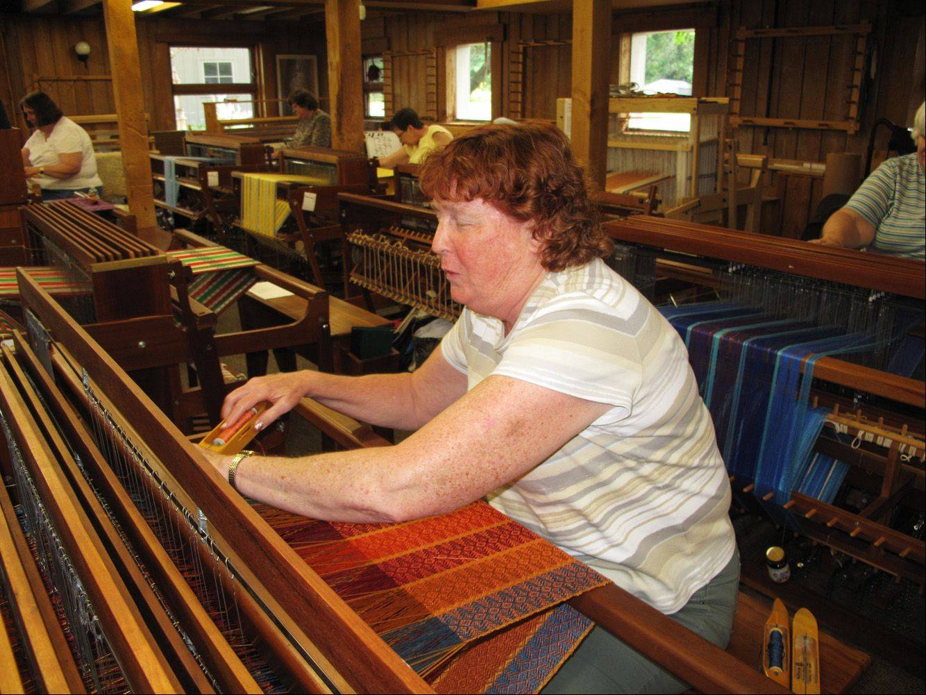 Sue Melrose is totally blind, but has learned to weave through a class at the Fine Line Creative Arts Center in St. Charles.