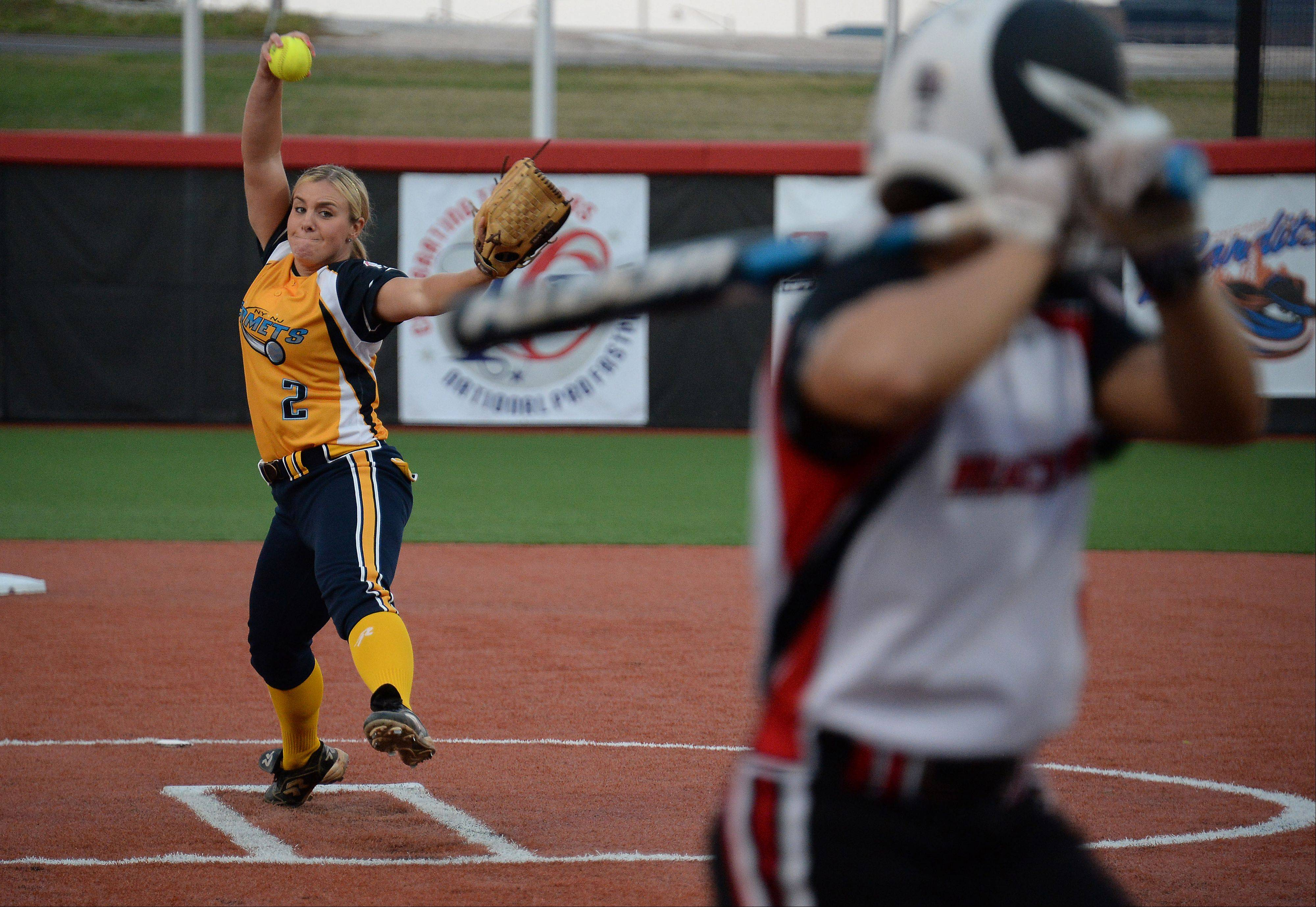 Comets pitcher Olivia Galiti fires battles a Racers batter in the first inning of the National Pro Fastpitch 2013 Championship Series in Rosemont on Thursday. Akron won the game 4-2 to advance.