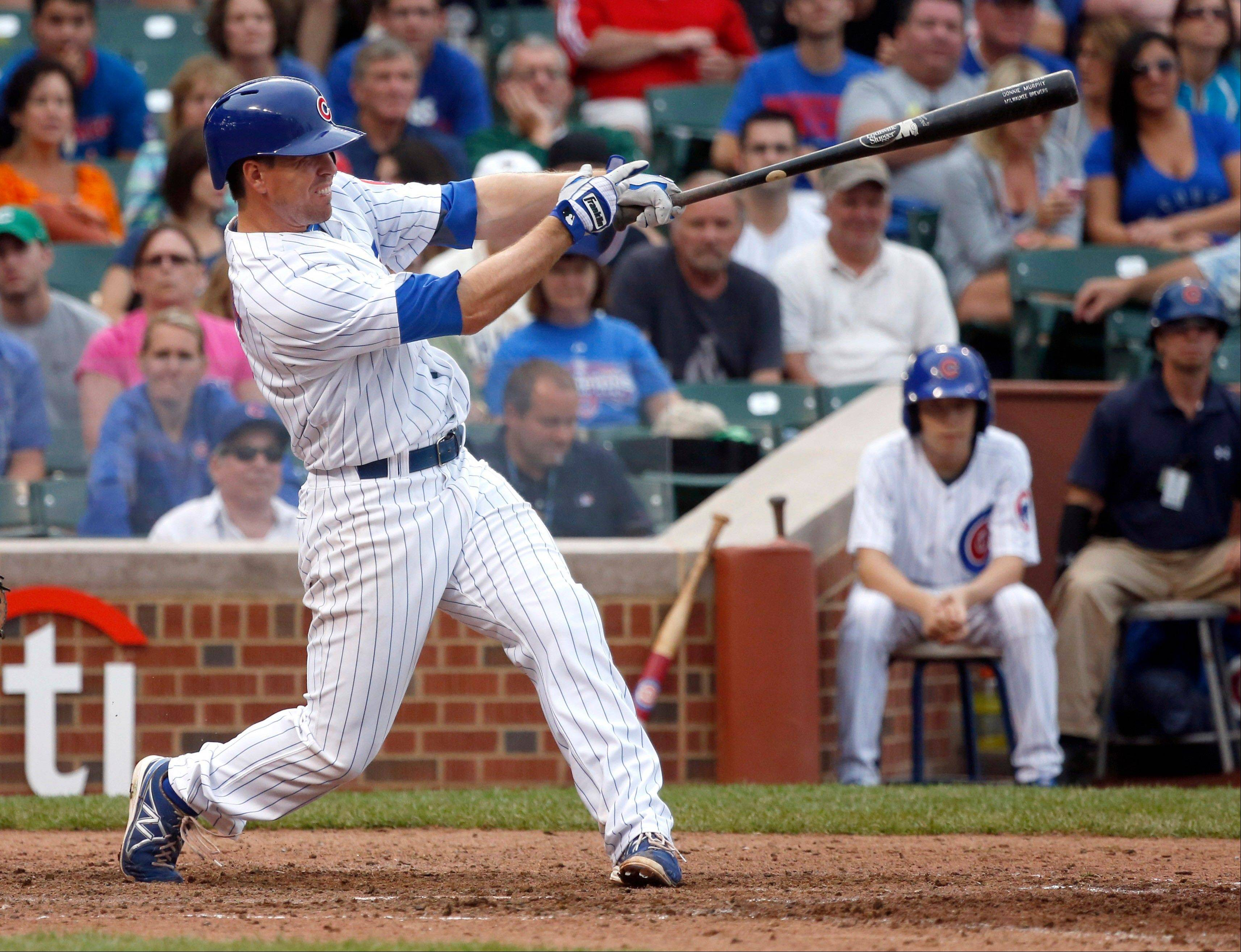 Chicago Cubs' Donnie Murphy hits a game-tying two-run home run off Washington Nationals starting pitcher Stephen Strasburg during the ninth inning of a baseball game on Thursday, Aug. 22, 2013, in Chicago.