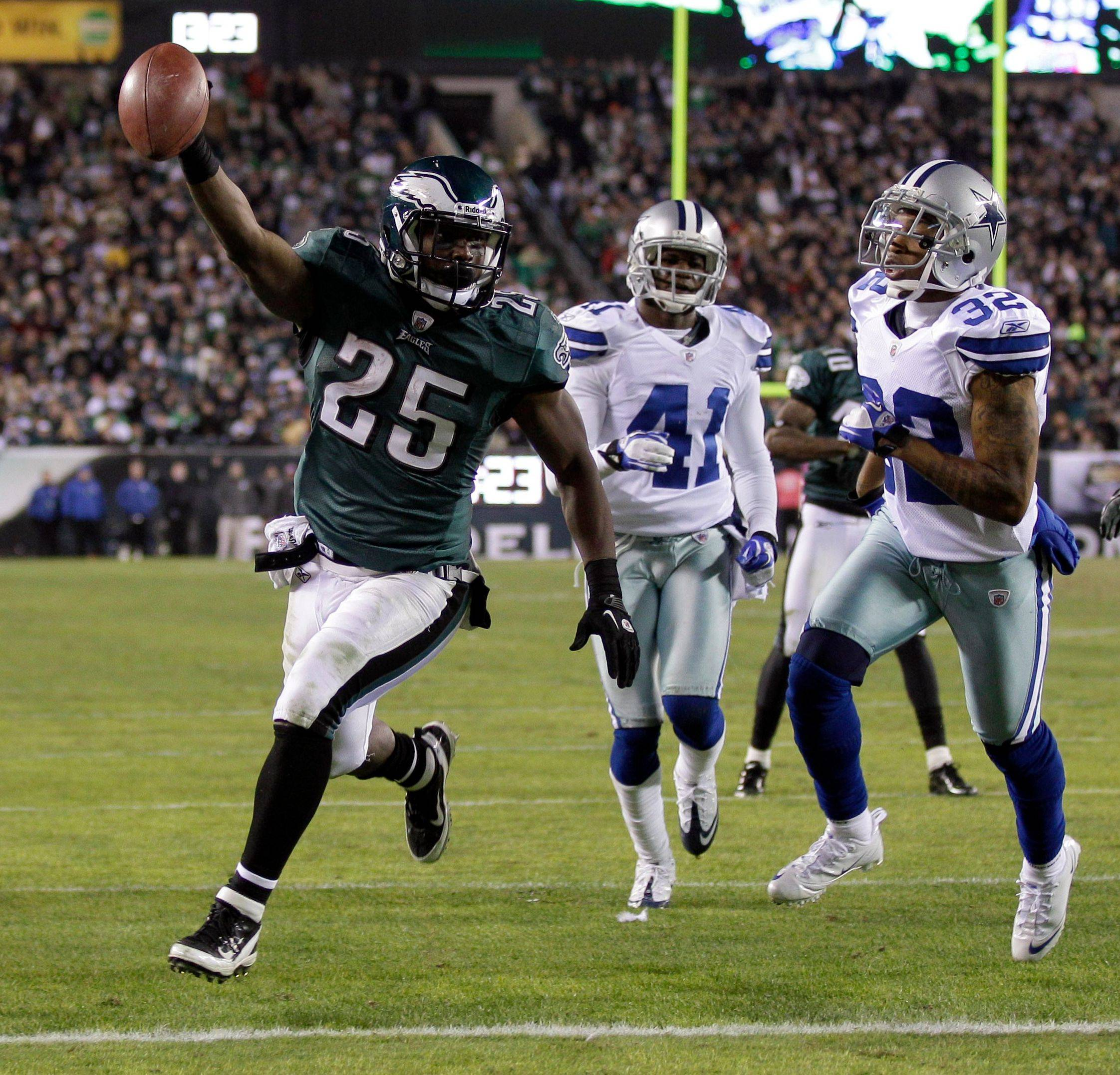 Eagles running back LeSean McCoy holds the ball up as he scores a touchdown against the Cowboys in 2011. McCoy had a rough season in 2012, but he did score 20 TDs two years ago.
