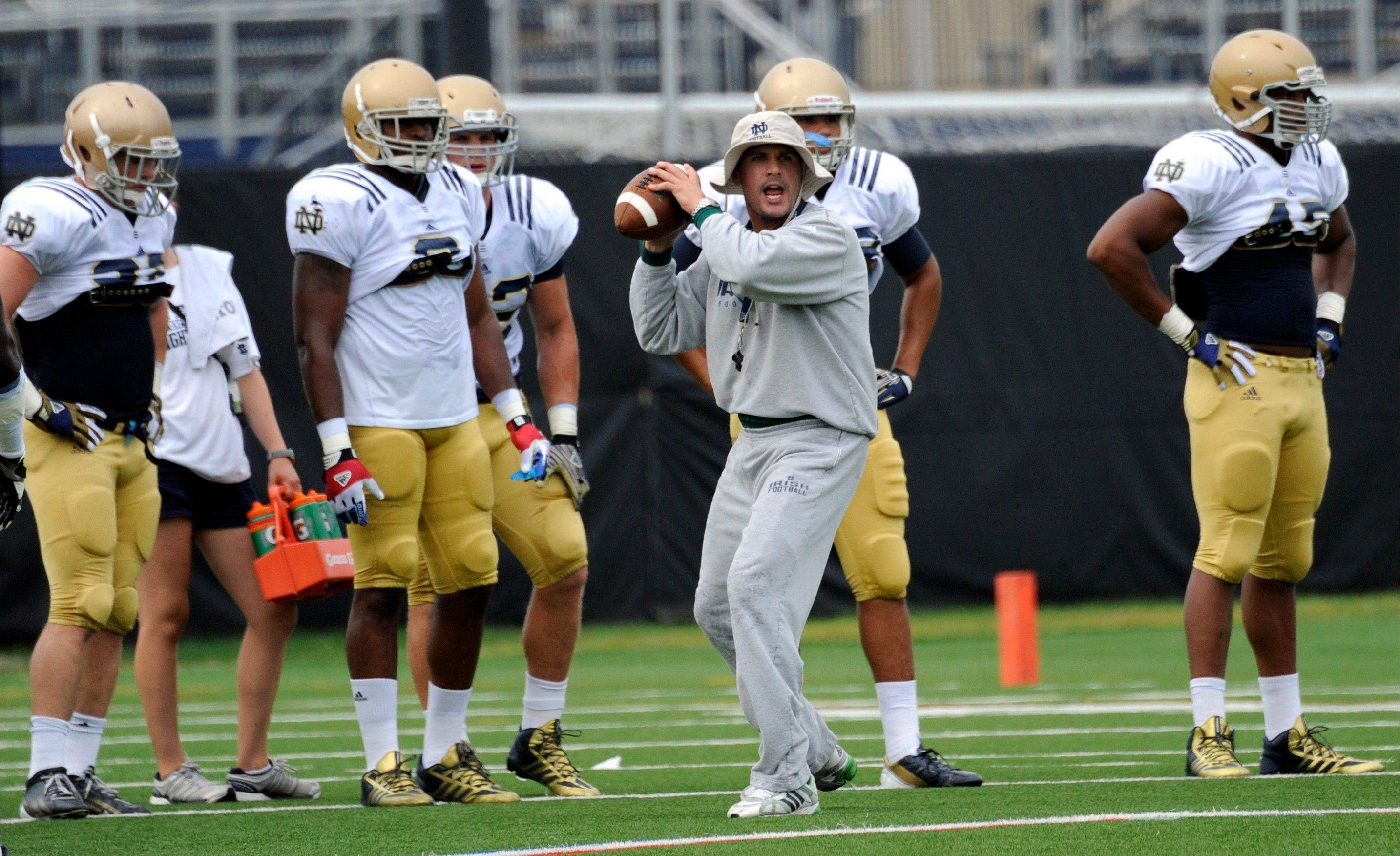 Coordinator Bob Diaco works with the Notre Dame defense during practice Thursday in South Bend, Ind.