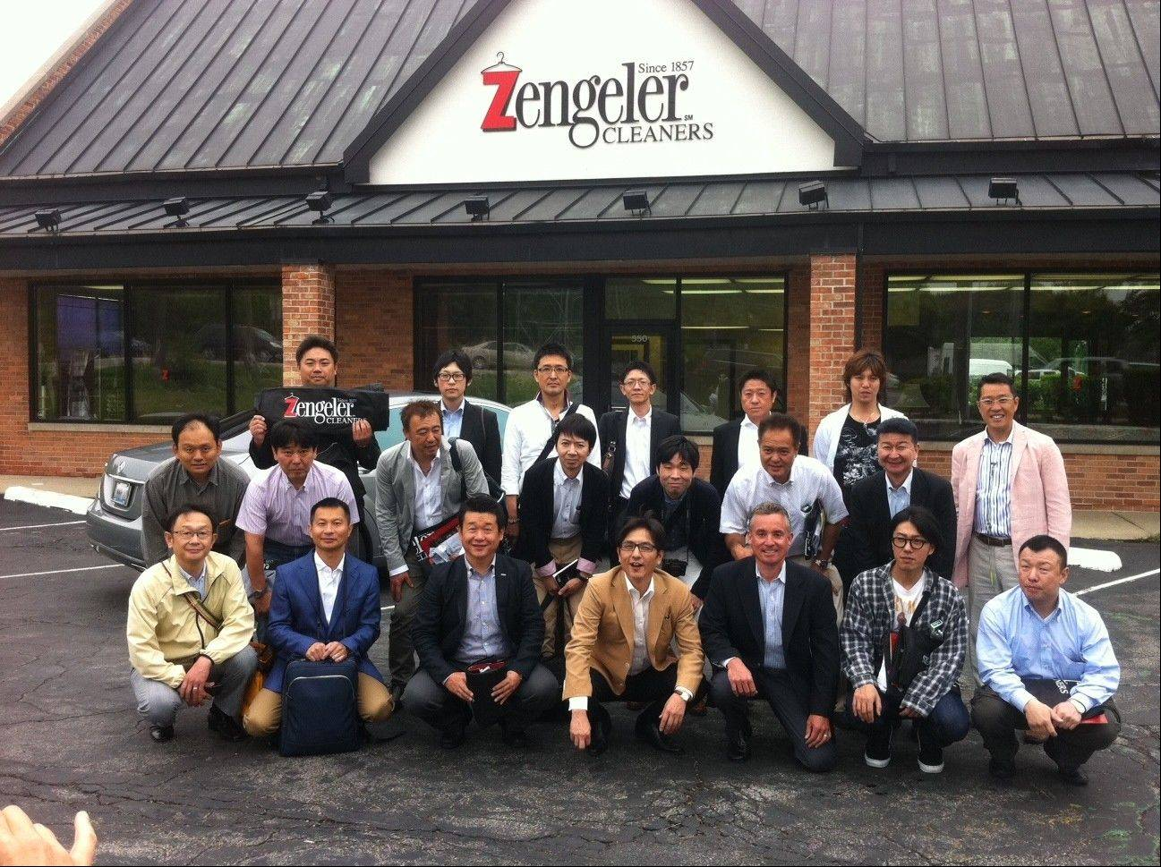 Tom Zengeler, front row, third from left, hosts a delegation of dry cleaning operators from Japan is below.