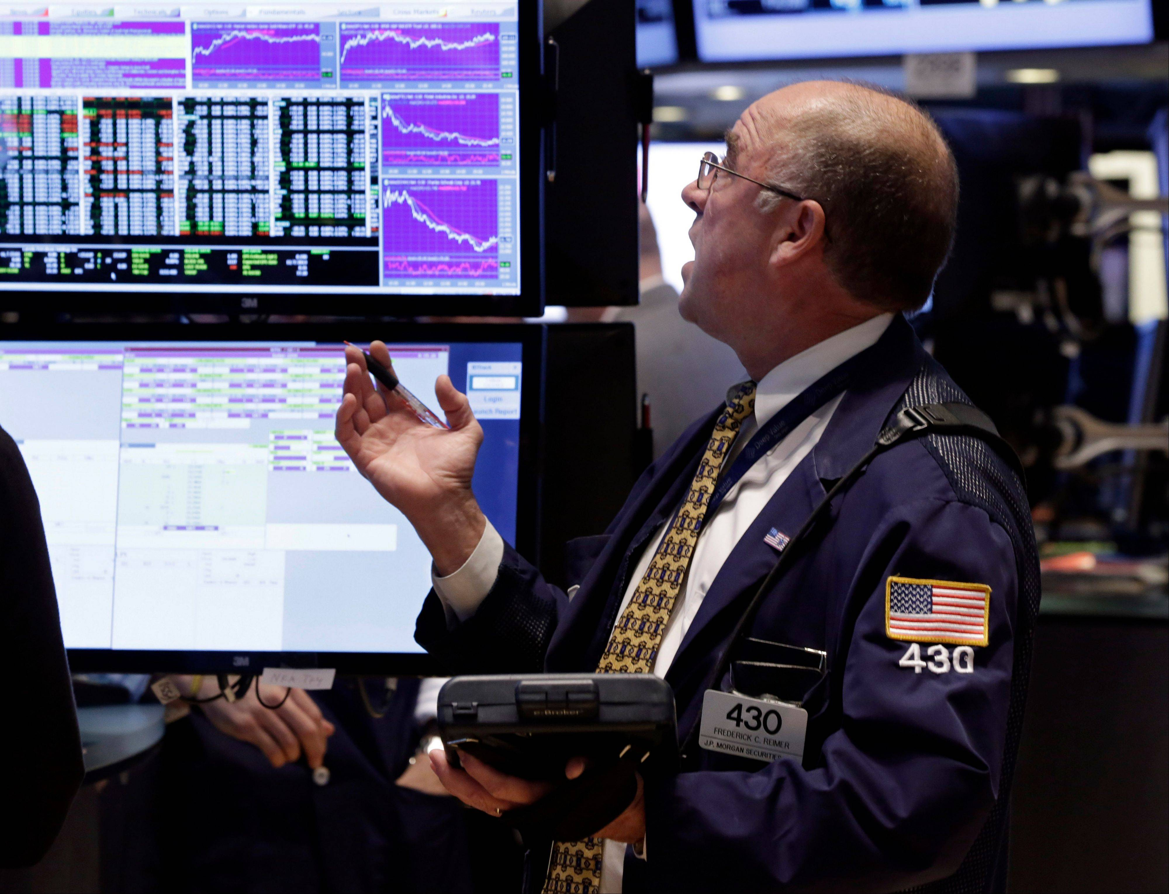 Trader Frederick Reimer works on the floor of the New York Stock Exchange.