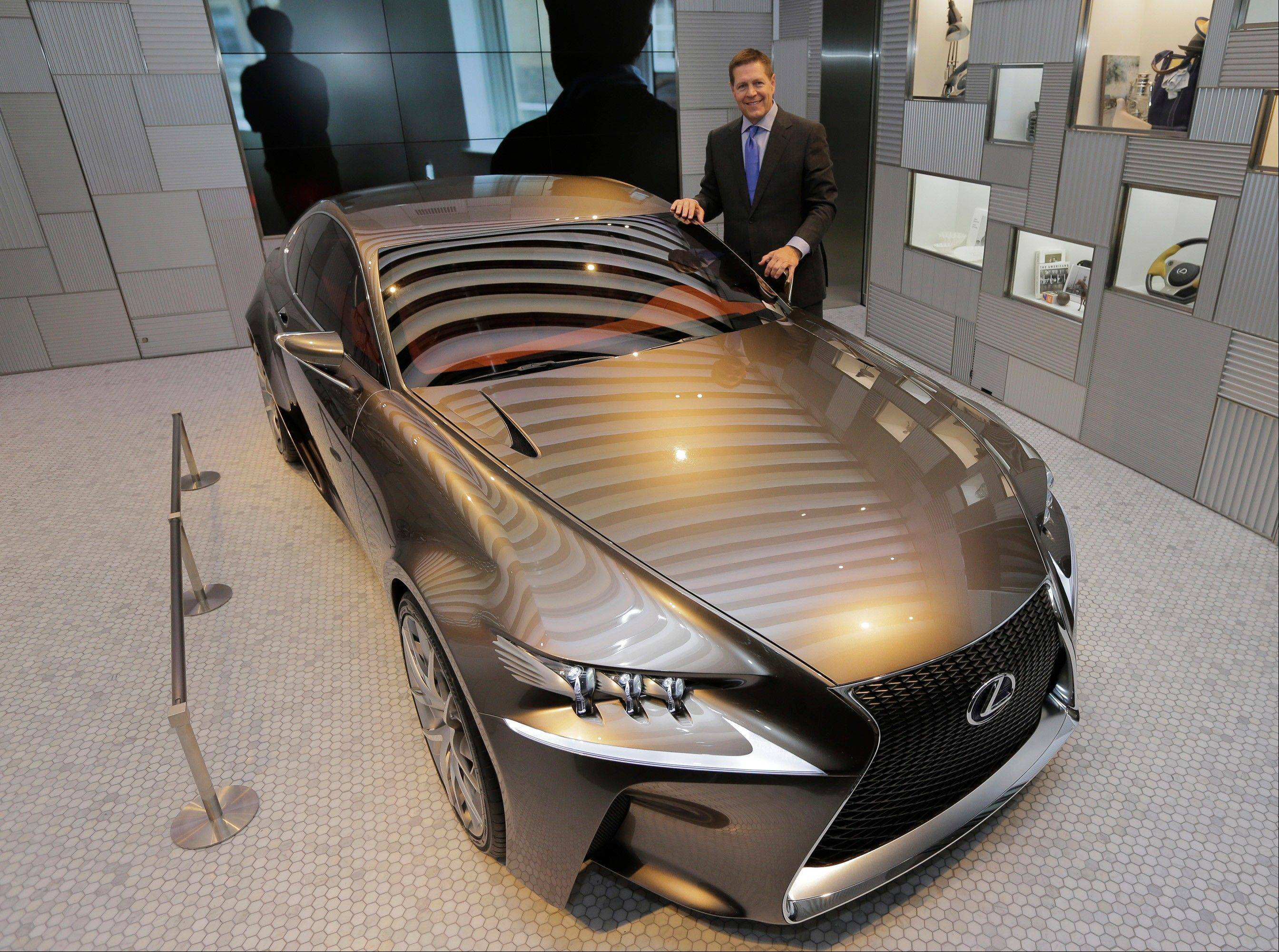 Lexus International Executive Vice President Mark Templin poses Friday with a Lexus LF-CC concept car at a Lexus showroom in Tokyo. Toyota�s luxury brand Lexus is trying to shake off its stodgy image. So it�s opening a cafe. The special lounges, the first of which is opening next week in Tokyo�s fashionable Aoyama district, are designed to look more like a chic home than a standard showroom. In fact, only one vehicle can be displayed at a time.