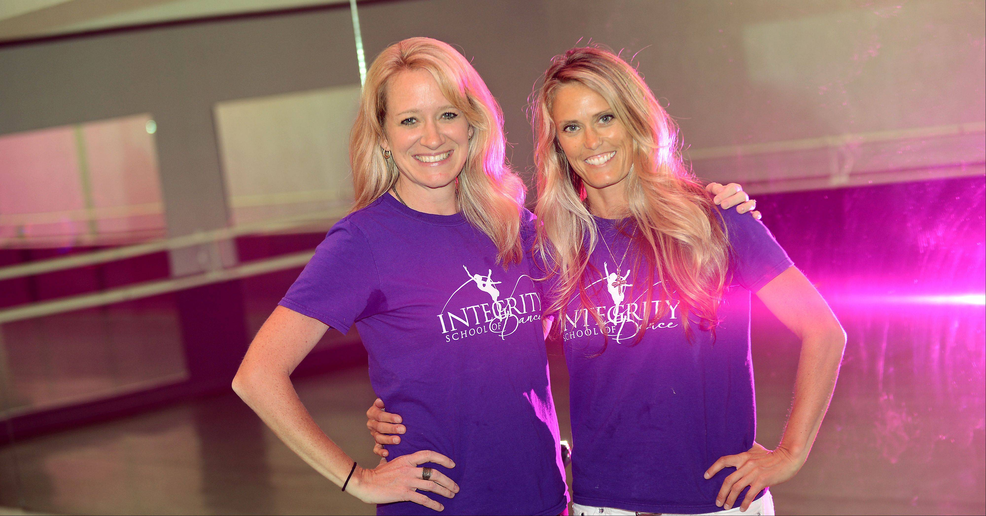 Kelly Hill, left, and Elisabeth Stonebreaker McCoy will host a grand opening for Integrity School of Dance in Elgin Sunday. The studio was formerly Gould Academy of Dance Arts, a longtime staple of Elgin�s artistic community. The two both taught there.