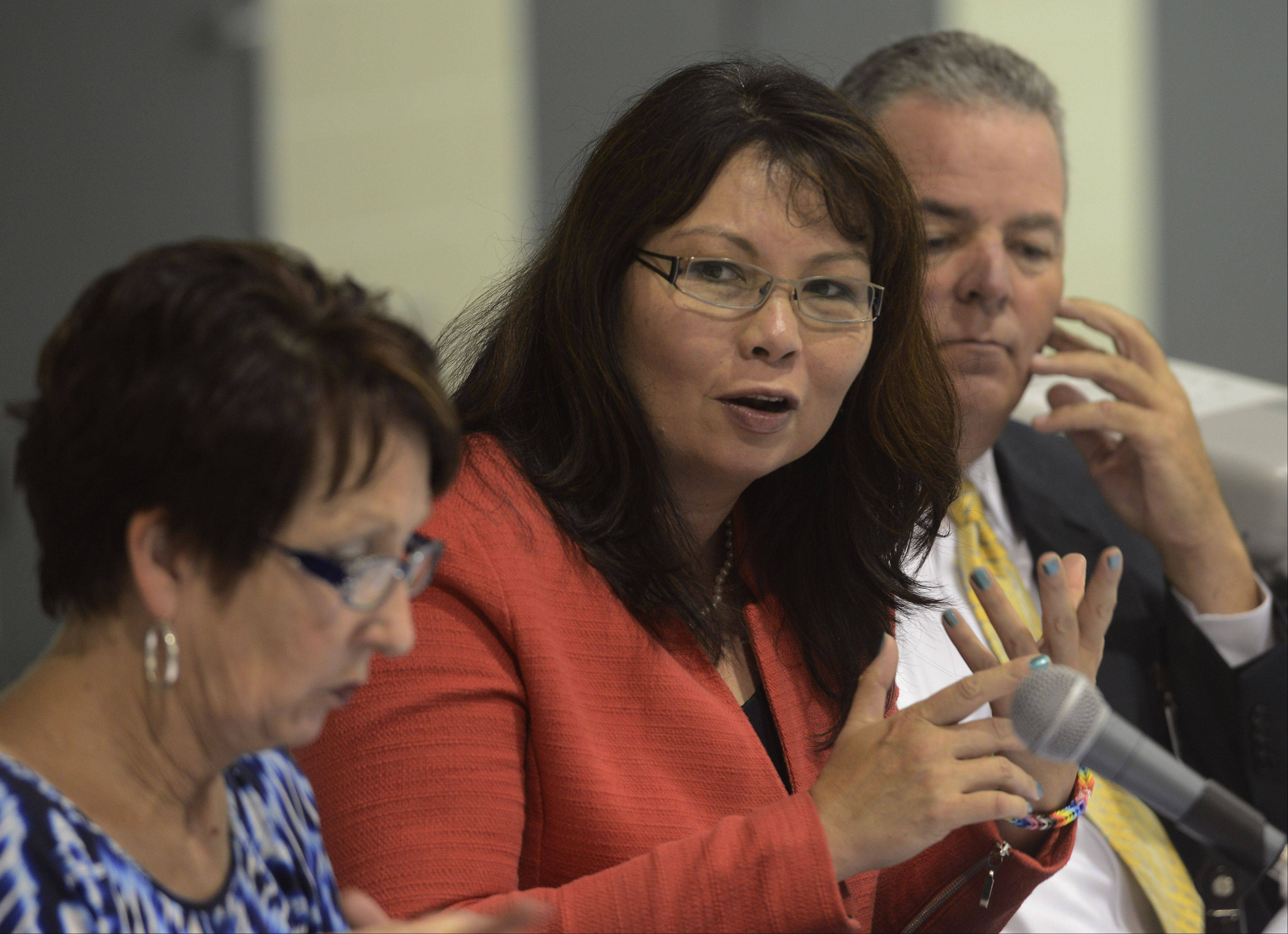 U.S. Rep. Tammy Duckworth leads a panel discussion Thursday at Carl Sandburg Junior High in Rolling Meadows on the importance of early science, technology, engineering and mathematics (STEM) education.
