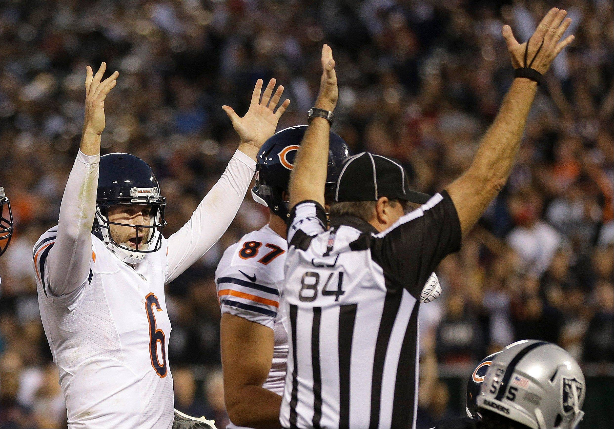 Chicago Bears quarterback Jay Cutler (6) celebrates a touchdown run by running back Michael Bush during the second quarter of an NFL preseason football game against the Oakland Raiders in Oakland, Calif., Friday, Aug. 23, 2013. (AP Photo/Marcio Jose Sanchez)