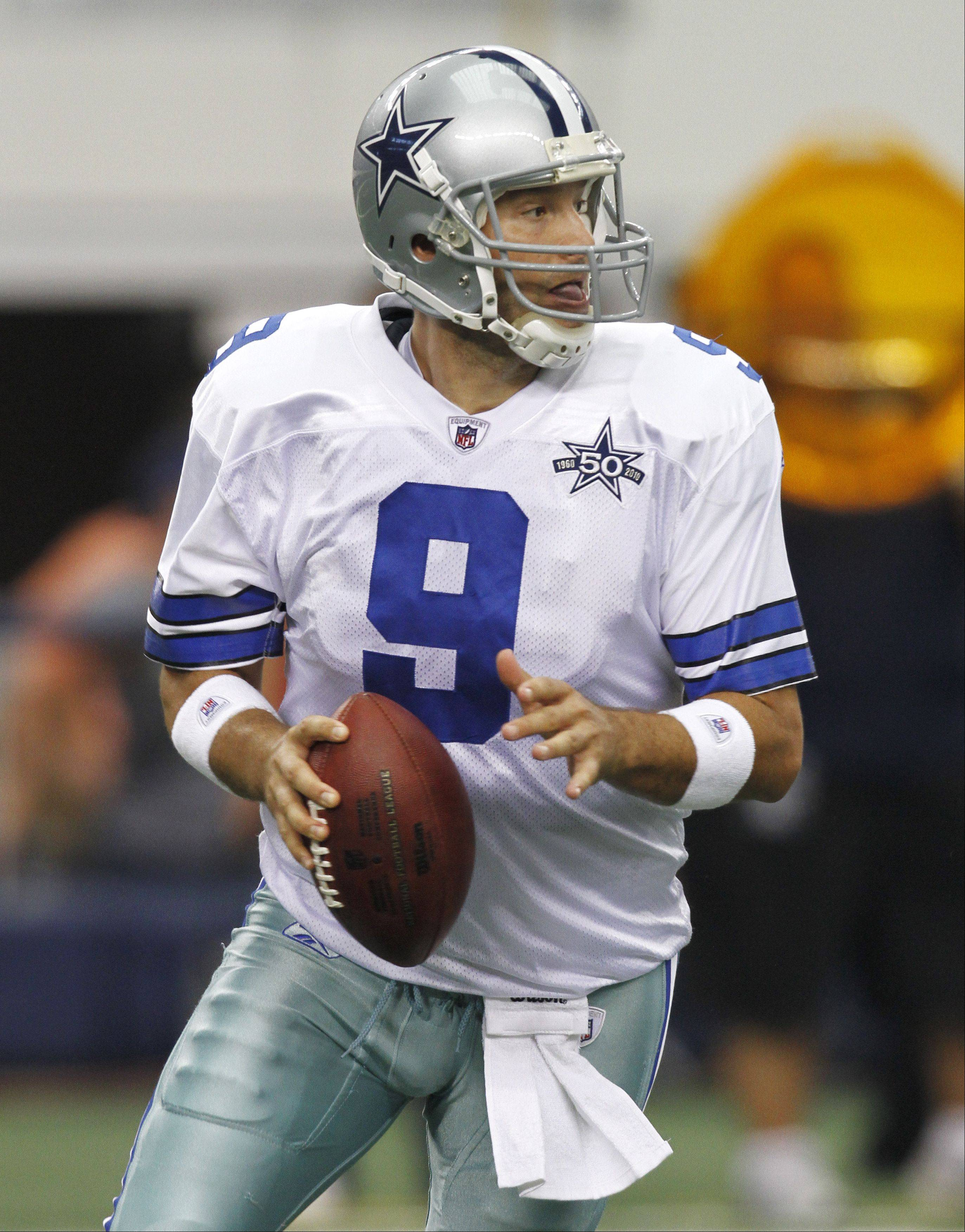Dallas Cowboys quarterback Tony Romo (9) looks for an open receiver in the first half of an NFL football game against the Chicago Bears, Sunday, Sept. 19, 2010, in Arlington, Texas. (AP Photo/Tim Sharp)