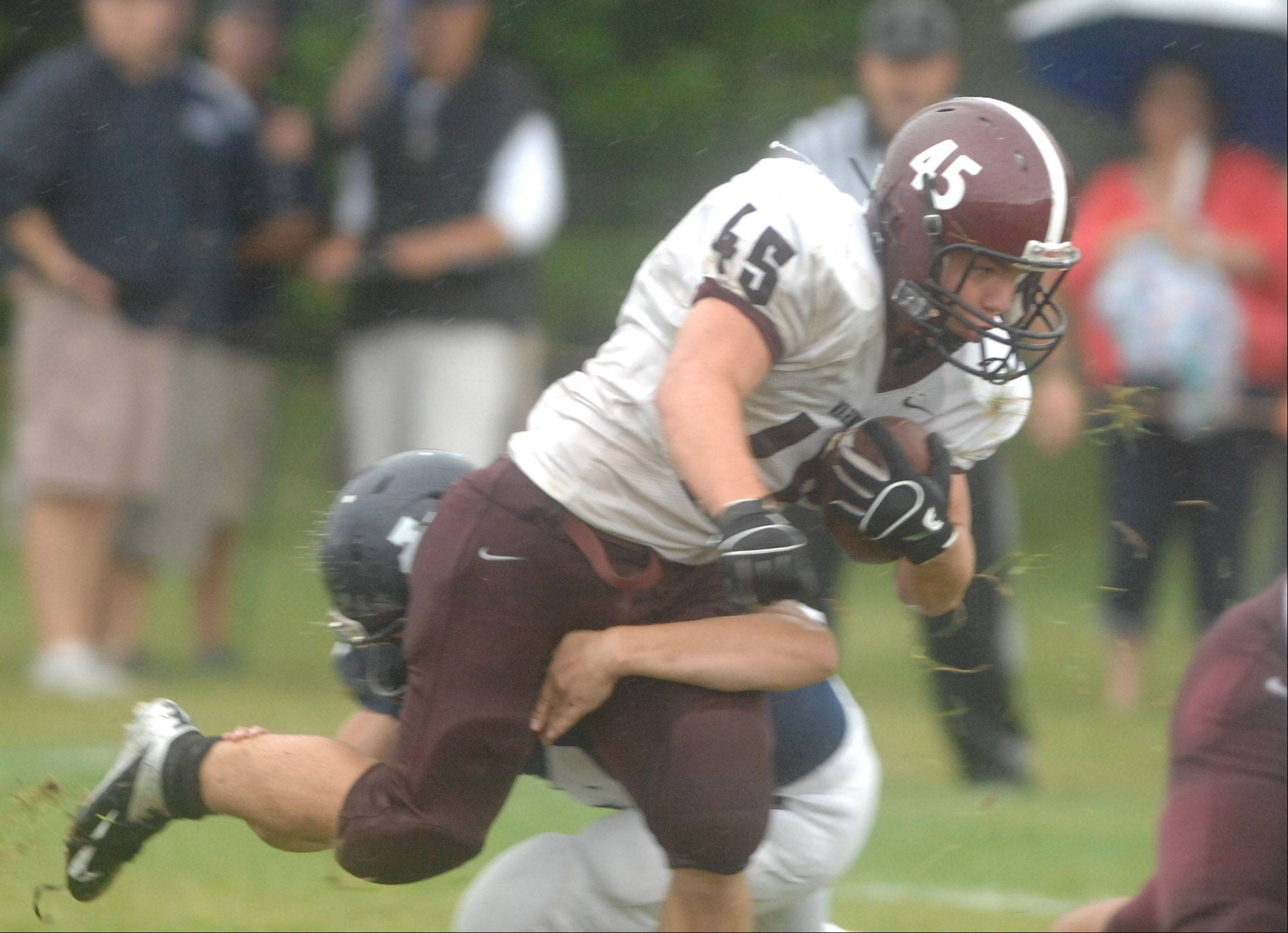 John Gemmel of Wheaton Academy plows through the line against IC Catholic Prep last season.