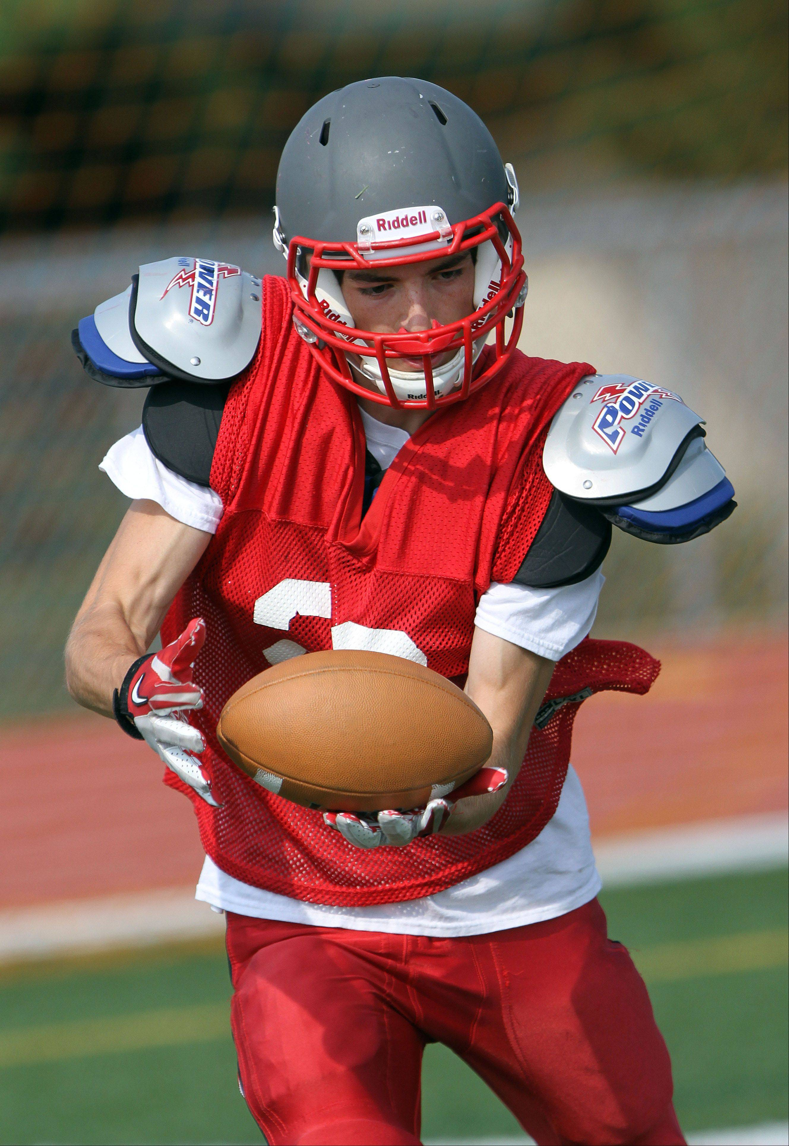Dillon O'Donoghue runs through drills during preseason practice at Mundelein.