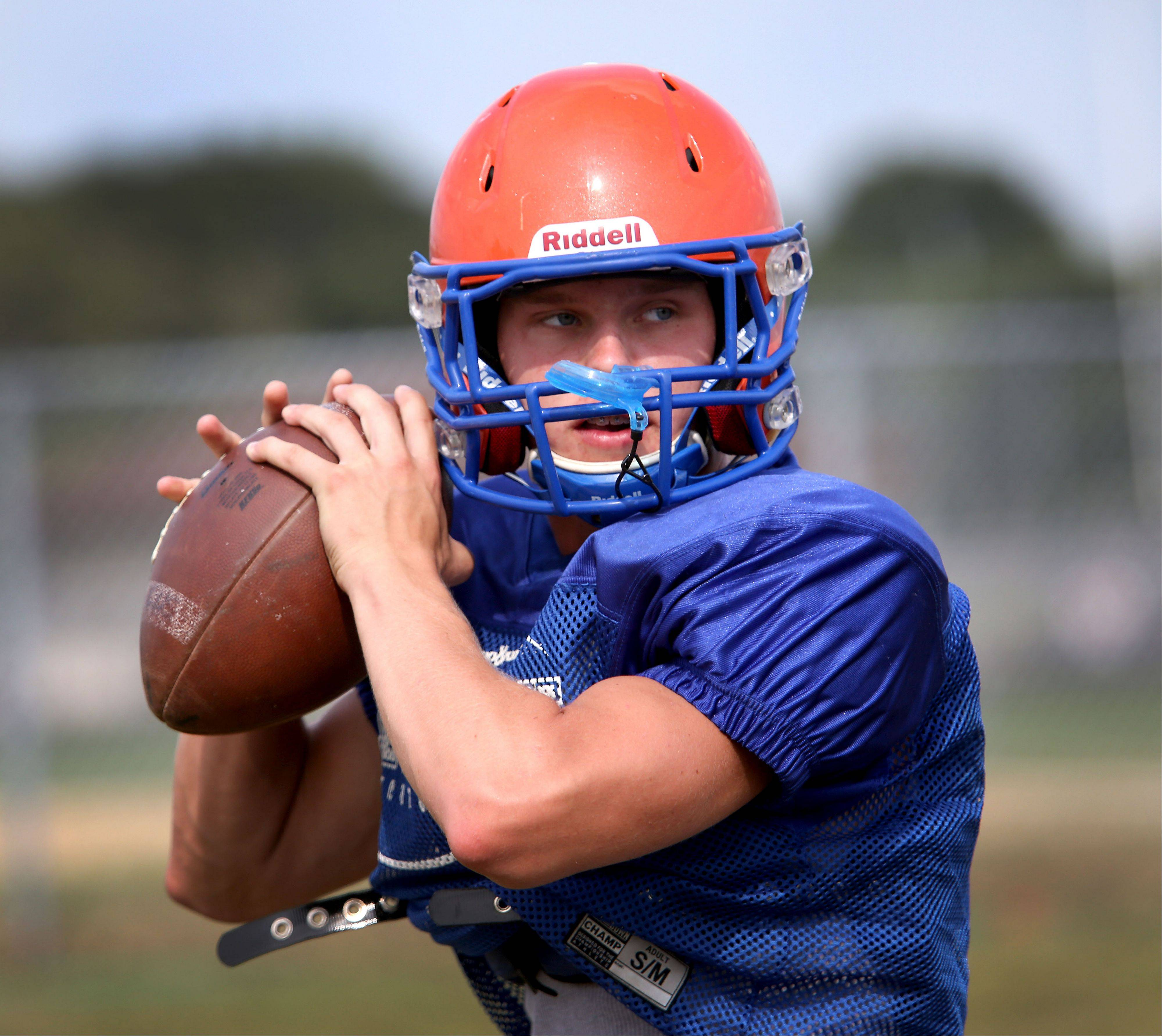 Quarterback Willie Wassmann runs through a drill during Fenton football practice in Bensenville.