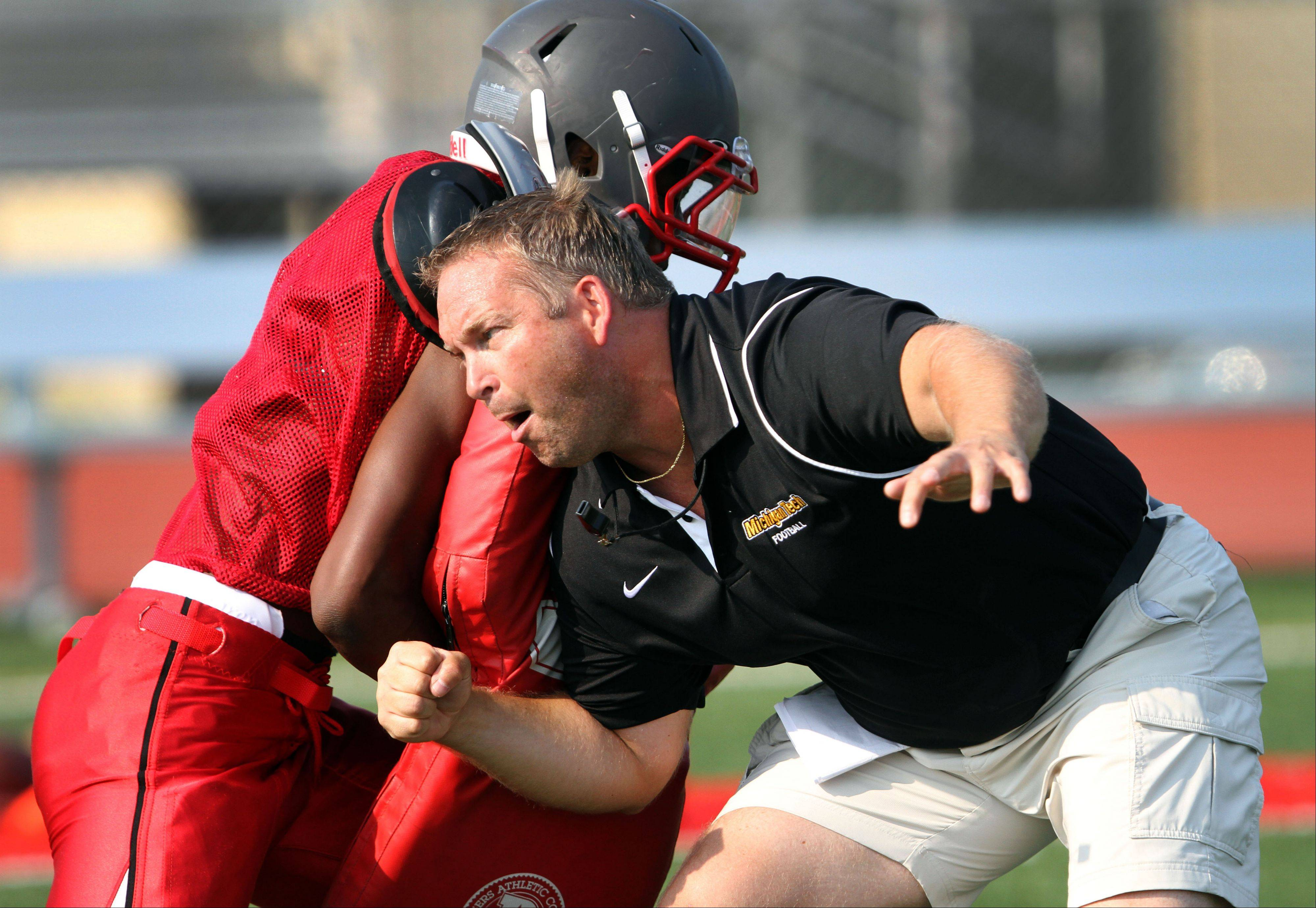 Coach George Kaider gets personally involved in Mundelein�s success in practice Tuesday at Mundelein.